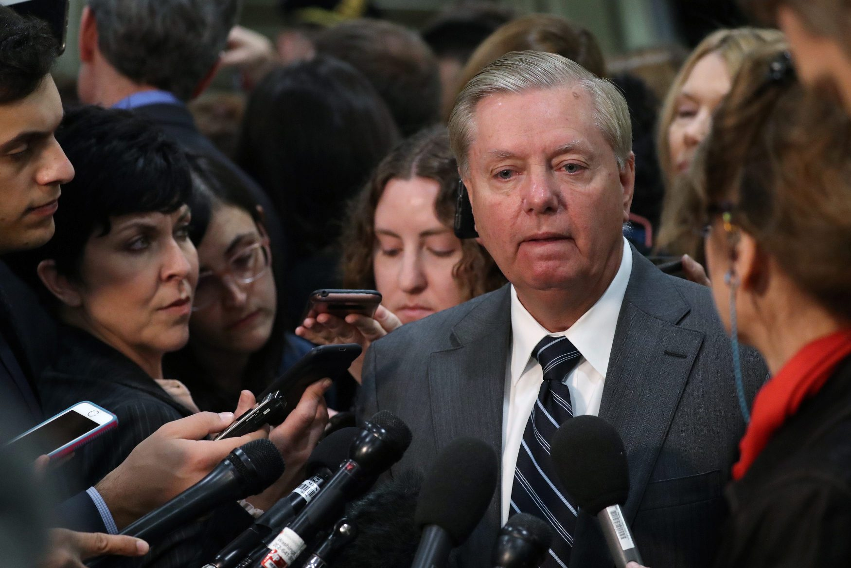 U.S. Senator Lindsey Graham (R-SC) speaks to reporters after attending a closed-door briefing, on the death of the journalist Jamal Khashoggi, by Central Intelligence Agency (CIA) Director Gina Haspel at the U.S. Capitol in Washington, U.S., December 4, 2018. REUTERS/Jonathan Ernst