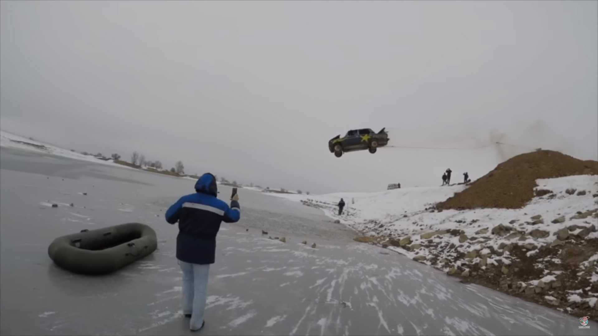 flaming-car-jumped-into-frozen-lake