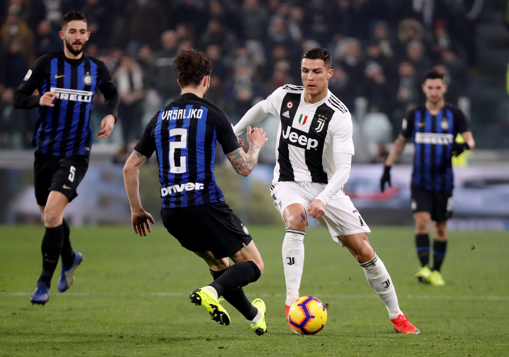 Soccer Football - Serie A - Juventus v Inter Milan - Allianz Stadium, Turin, Italy - December 7, 2018  Juventus' Cristiano Ronaldo in action with Inter Milan's Sime Vrsaljko   REUTERS/Stefano Rellandini