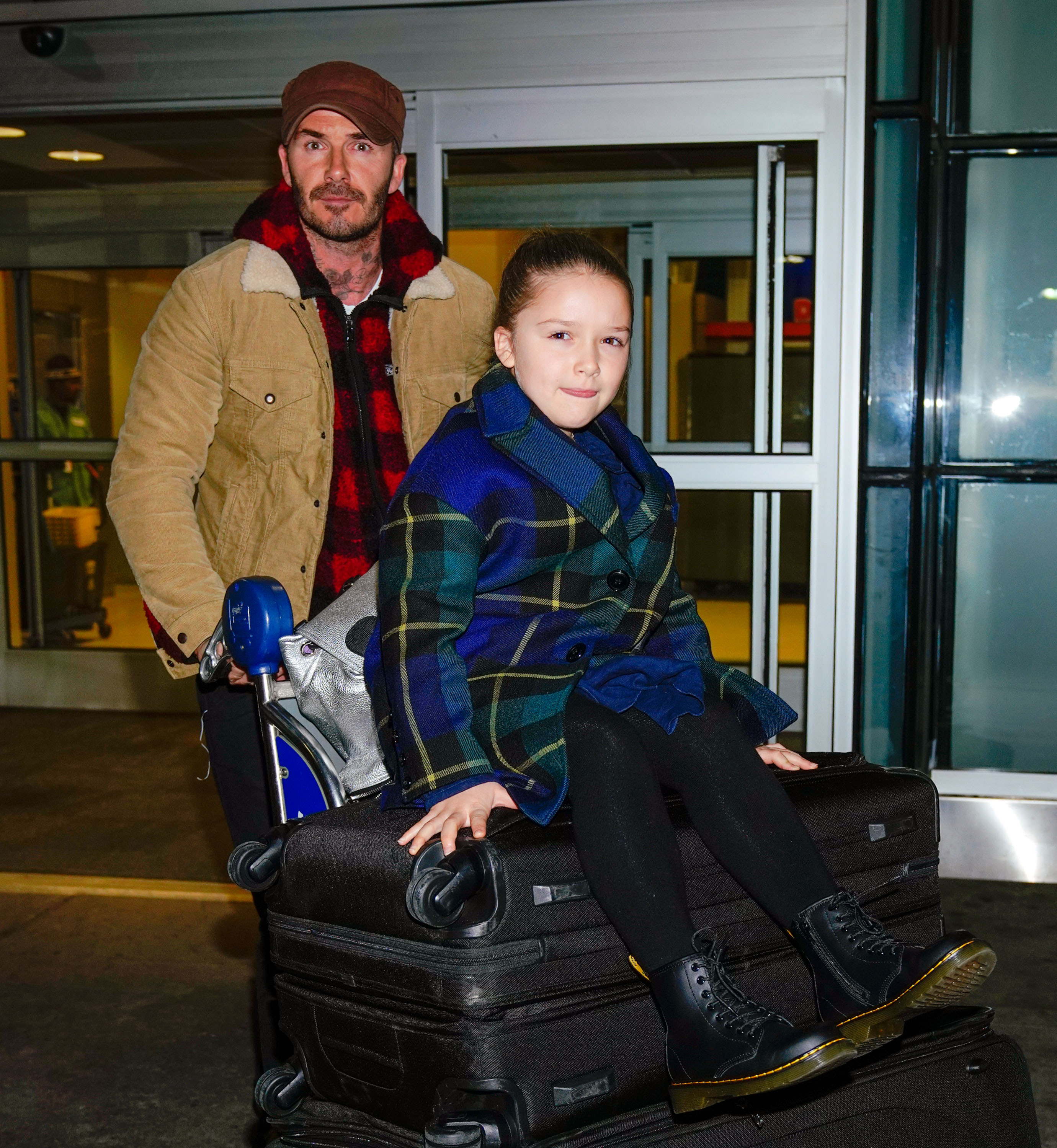 David Beckham pushes Harper on top of their luggage when arriving at JFK airport with sons Romeo and Cruz Beckham in New York <P> Pictured: David Beckham, Harper, Romeo and Cruz Beckham <B>Ref: SPL1657137  100218  </B><BR/> Picture by: Jackson Lee / Splash News<BR/> </P><P> <B>Splash News and Pictures</B><BR/> Los Angeles:310-821-2666<BR/> New York:212-619-2666<BR/> London:870-934-2666<BR/> <span id=