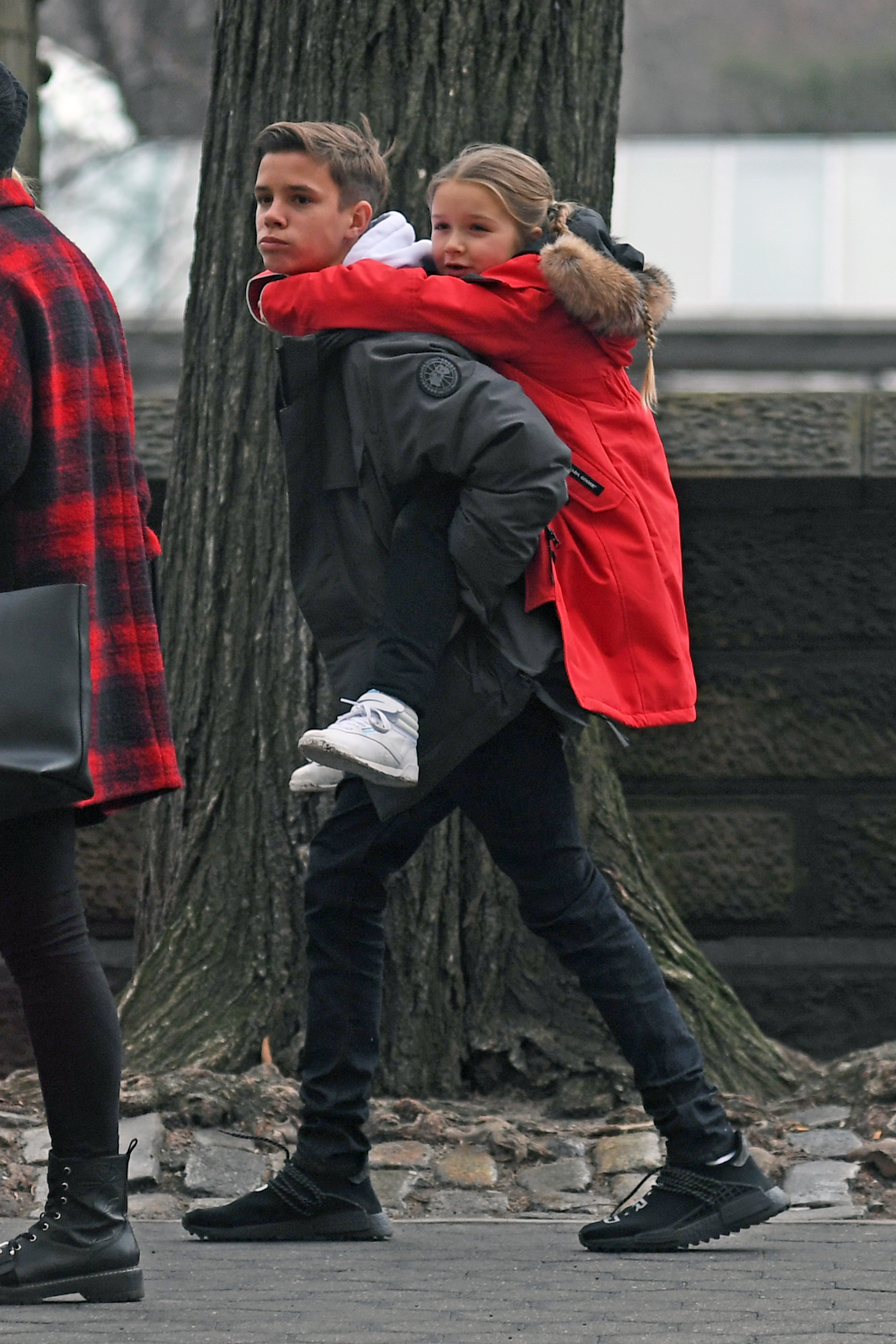 EXCLUSIVE: David Beckhamn's kids Romeo Beckham Is seen giving her sister Harper Beckham a piggy back while walking in Central Park New York city today <P> Pictured: Romeo Beckham, Harper Beckham  <B>Ref: SPL1657536  100218   EXCLUSIVE</B><BR/> Picture by: Elder Ordonez / Splash News<BR/> </P><P> <B>Splash News and Pictures</B><BR/> Los Angeles:310-821-2666<BR/> New York:212-619-2666<BR/> London:870-934-2666<BR/> <span id=