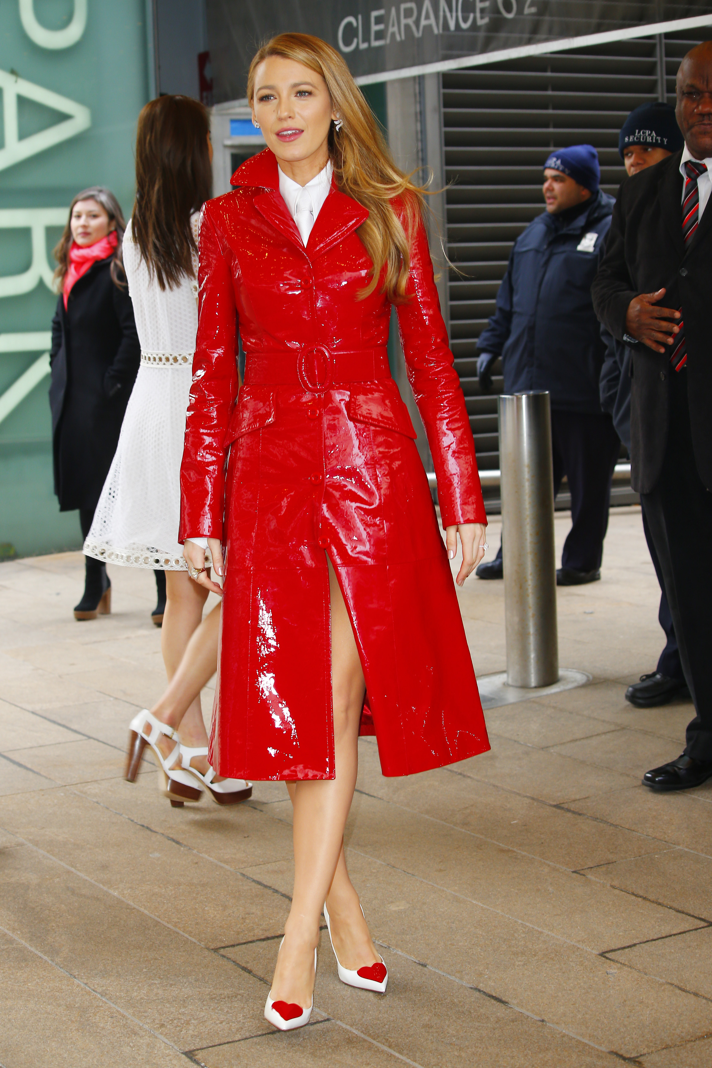 Blake Lively wears a bright red coat at Michael Kors fashion show in New York CIty <P> Pictured: Blake Lively <B>Ref: SPL1659366  140218  </B><BR/> Picture by: Edward Opi / Splash News<BR/> </P><P> <B>Splash News and Pictures</B><BR/> Los Angeles:	310-821-2666<BR/> New York:	212-619-2666<BR/> London:	870-934-2666<BR/> <span id=