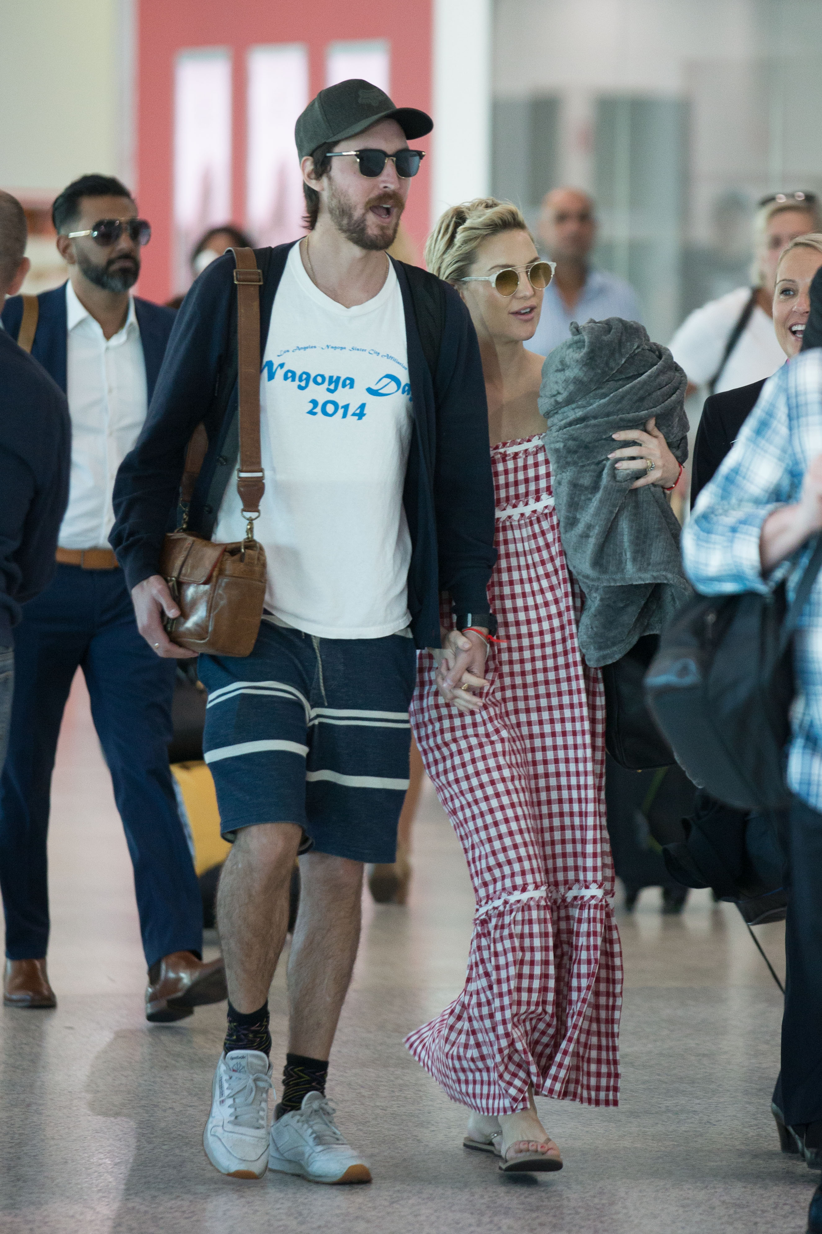 EXCLUSIVE: Kate Hudson & Boyfriend Danny Fujikawa are seen arriving into Melbourne airport. Kate Hudson and her boyfriend Danny Fujikawa were seen walking hand in hand as they arrived into Melbourne airport as Kate continues her business chicks tour of Australia. Kate was seen wearing a ring on her wedding finger sparking rumours that the two are now engaged.  <P> Pictured: Kate Hudson and Danny Fujikawa <B>Ref: SPL1661250  200218   EXCLUSIVE</B><BR/> Picture by: Splash News<BR/> </P><P> <B>Splash News and Pictures</B><BR/> Los Angeles:310-821-2666<BR/> New York:212-619-2666<BR/> London:870-934-2666<BR/> <span id=