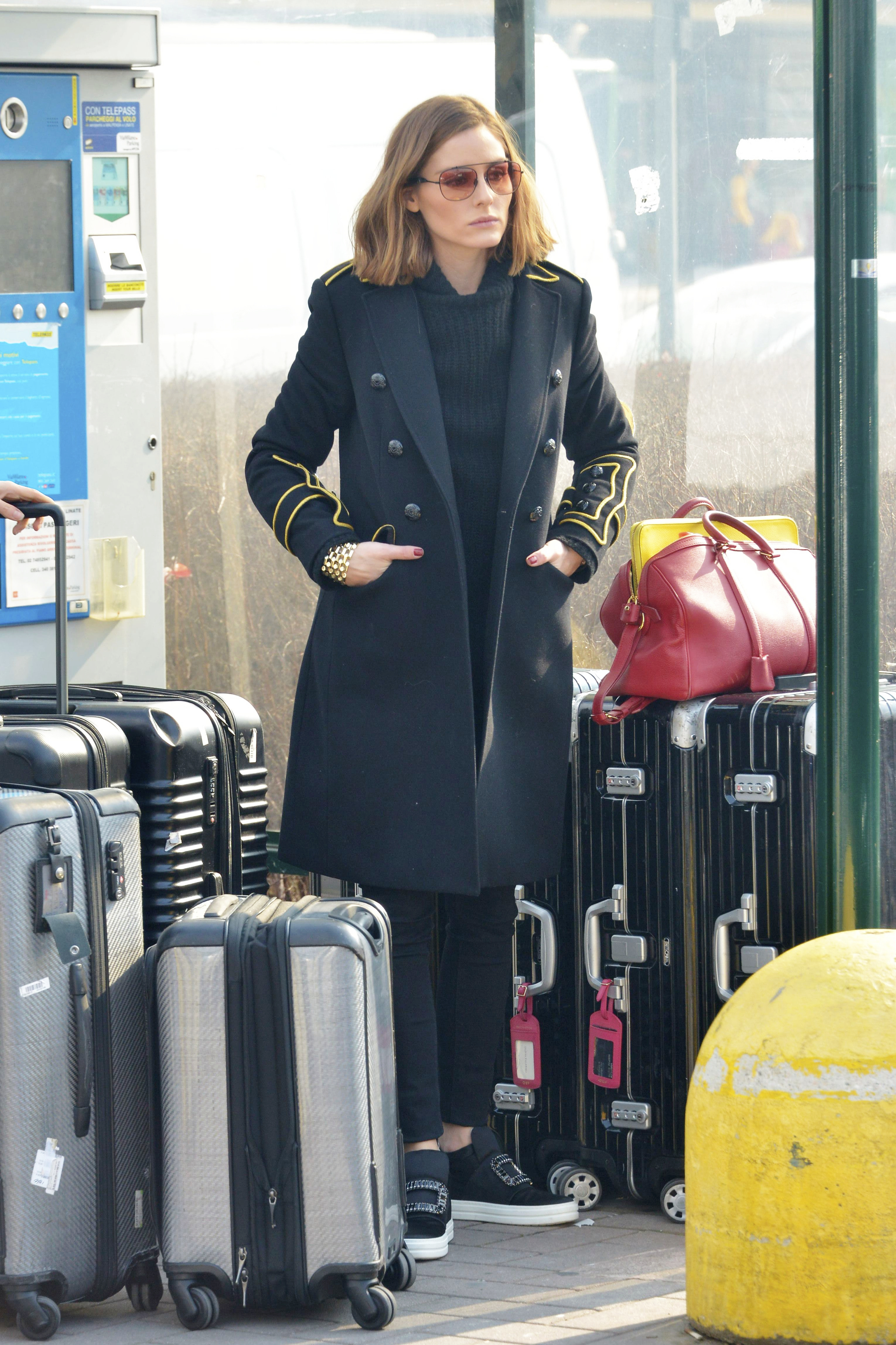 Olivia Palermo displays her perfect skin as the natural beauty arrives at Linate airport in Milan, Italy. February 20, 2018 X17online.com USA ONLY