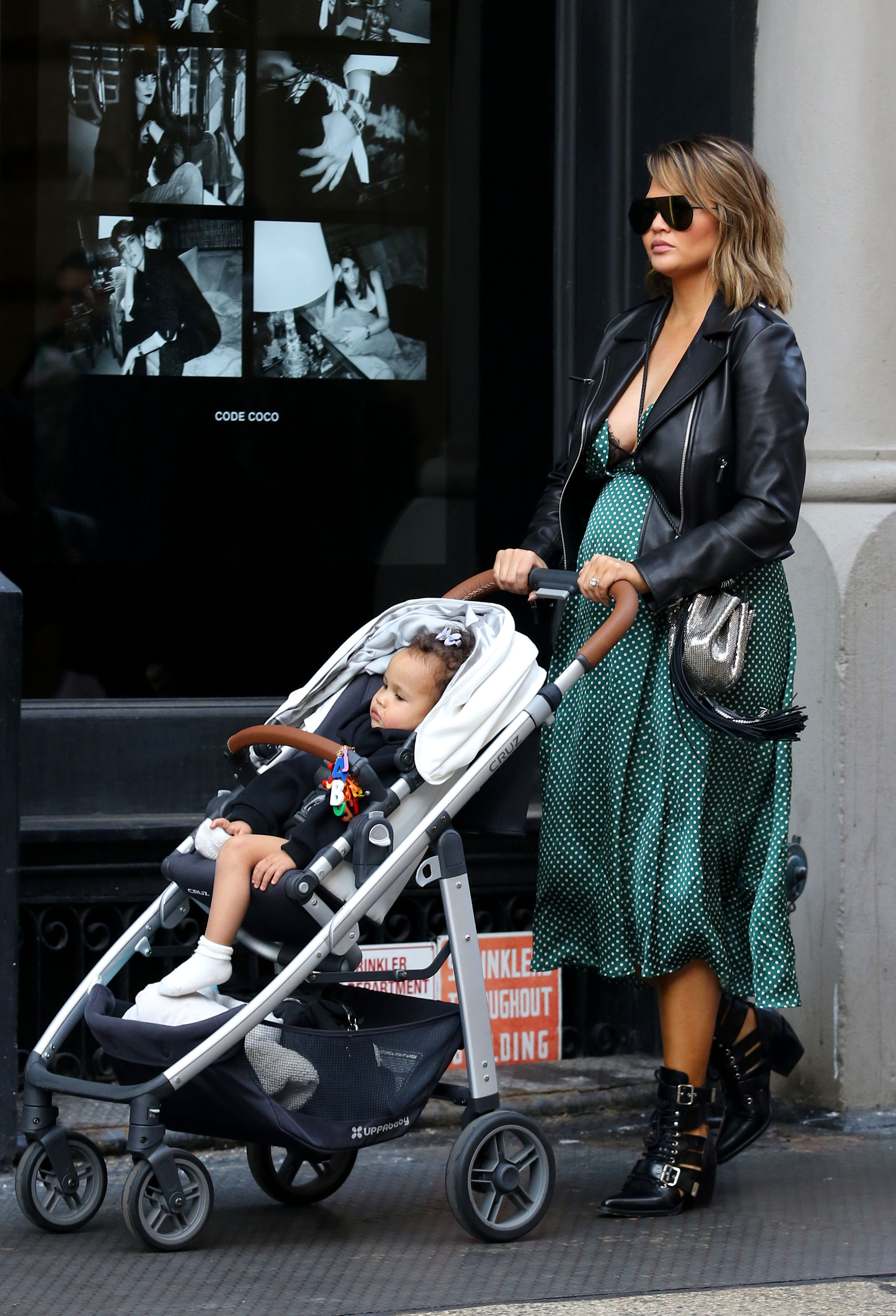 A pregnant Chrissy Teigen goes out for a walk with daughter around Manhattan's Soho Neighborhood. <P> Pictured: Chrissy Teigen <B>Ref: SPL1661560  200218  </B><BR/> Picture by: Splash News<BR/> </P><P> <B>Splash News and Pictures</B><BR/> Los Angeles:310-821-2666<BR/> New York:212-619-2666<BR/> London:870-934-2666<BR/> <span id=
