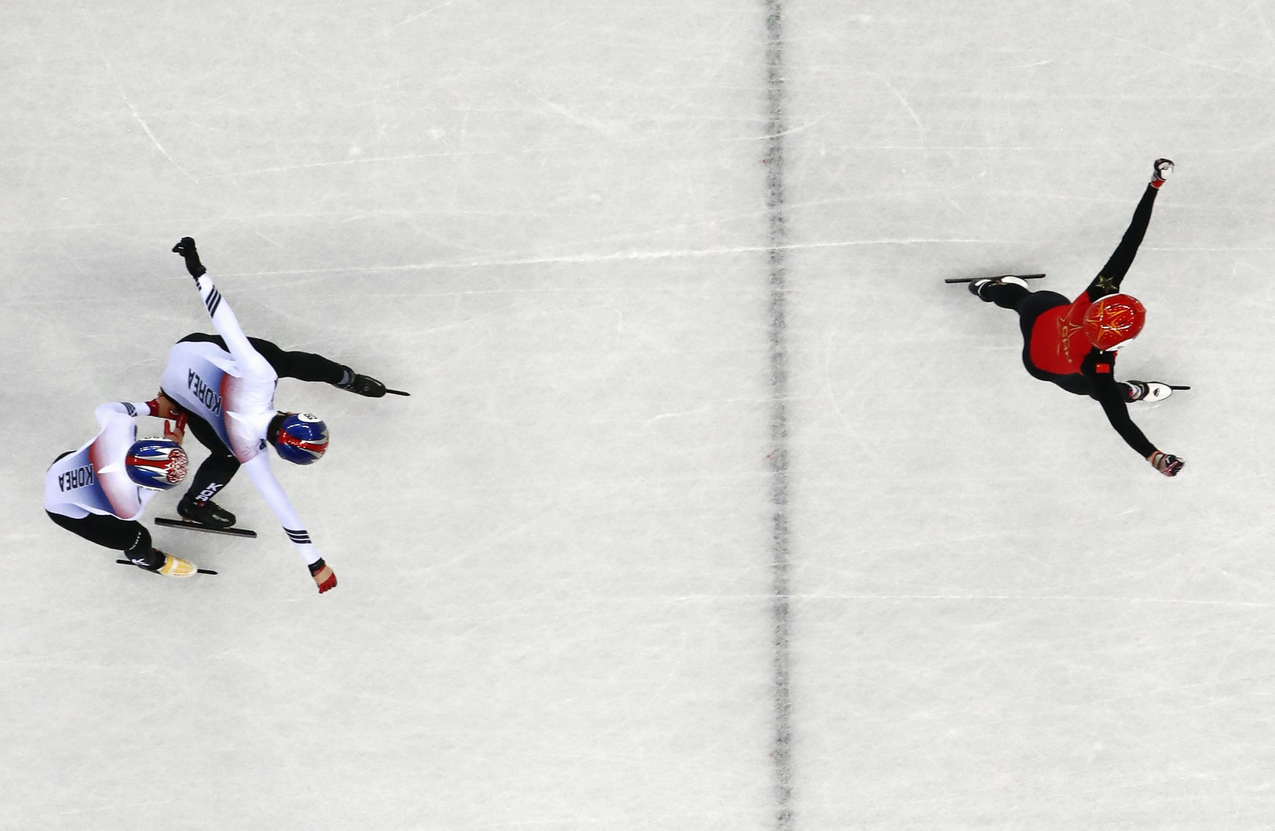 Short Track Speed Skating Events - Pyeongchang 2018 Winter Olympics - Men's 500m Finals - Gangneung Ice Arena - Gangneung, South Korea - February 22, 2018 - Gold medallist Wu Dajing of China skates to victory ahead of silver medallist Hwang Dae-heon of South Korea and bronze medallist Lim Hyo-jun of South Korea. REUTERS/Lucy Nicholson
