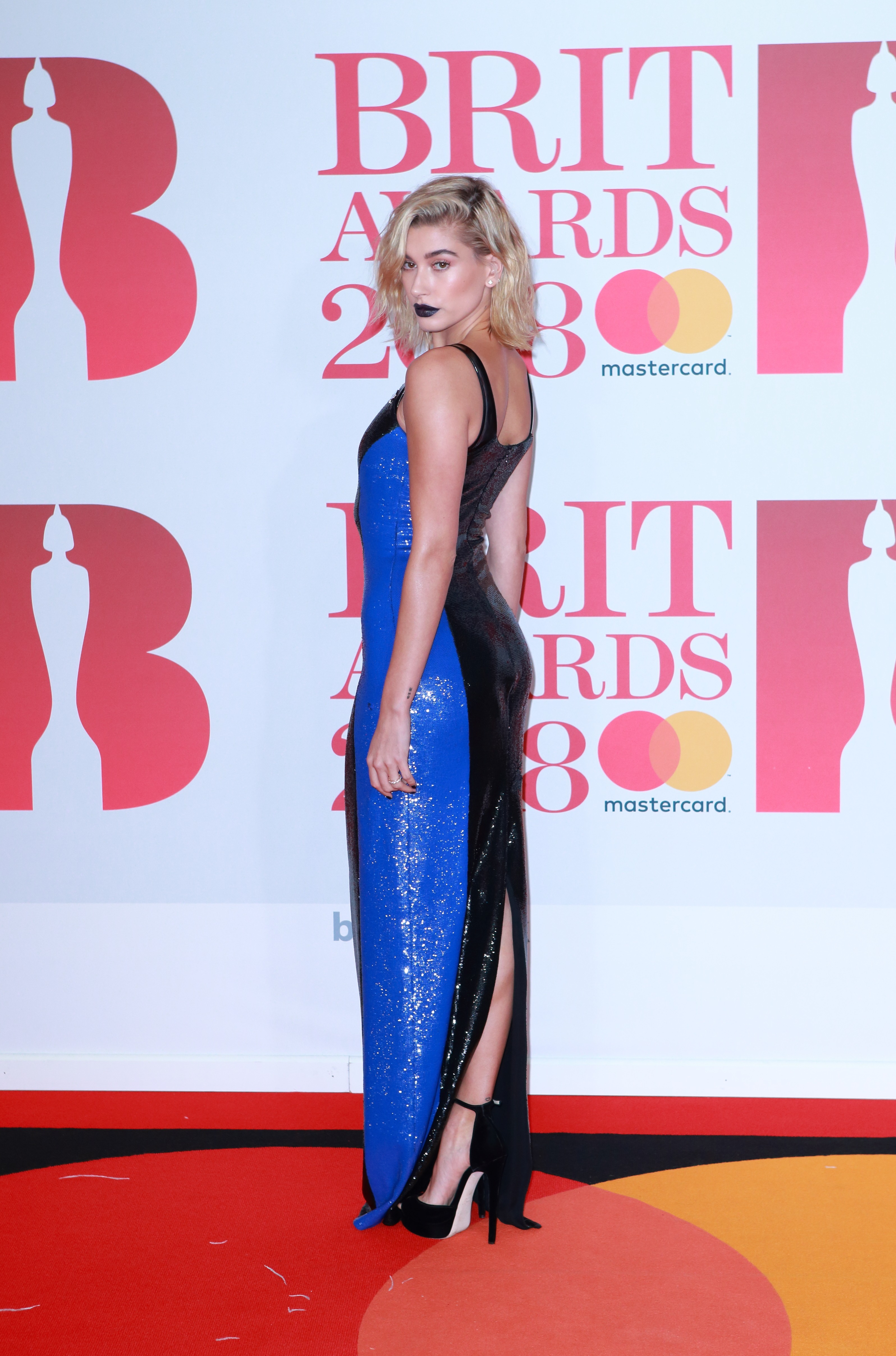 Hailey Baldwin arrive on the red carpet for The BRIT Awards 2018 at The O2 Arena in London, UK. <P> Pictured: Hailey Baldwin <B>Ref: SPL1662525  210218  </B><BR/> Picture by: Flynet - Splash News<BR/> </P><P> <B>Splash News and Pictures</B><BR/> Los Angeles:	310-821-2666<BR/> New York:	212-619-2666<BR/> London:	870-934-2666<BR/> <span id=