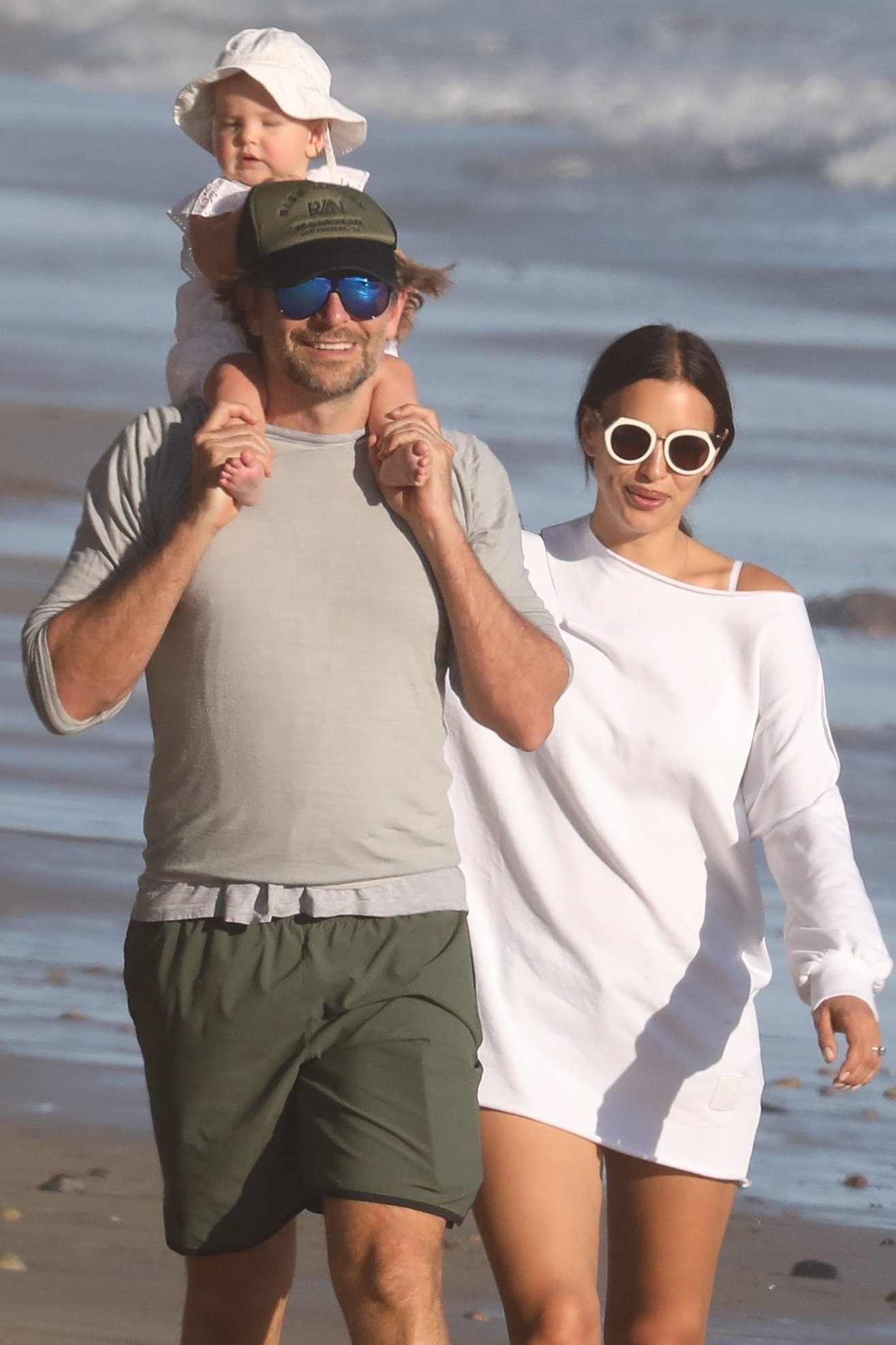 ** RIGHTS: WORLDWIDE EXCEPT IN ITALY ** Malibu, CA  - *EXCLUSIVE* **WEB MUST CALL FOR PRICING** - Bradley Cooper and Irina Shayk took baby Lea De Seine for a stroll at the beach in Malibu. Bradley could be seen teaching daughter Lea De Seine her first steps while mom Irina watched closely. Shot on 10/22/17  Pictured: Bradley Cooper, Irina Shayk, Lea De Seine    *UK Clients - Pictures Containing Children Please Pixelate Face Prior To Publication*, Image: 353866024, License: Rights-managed, Restrictions: , Model Release: no, Credit line: Profimedia, AKM-GSI