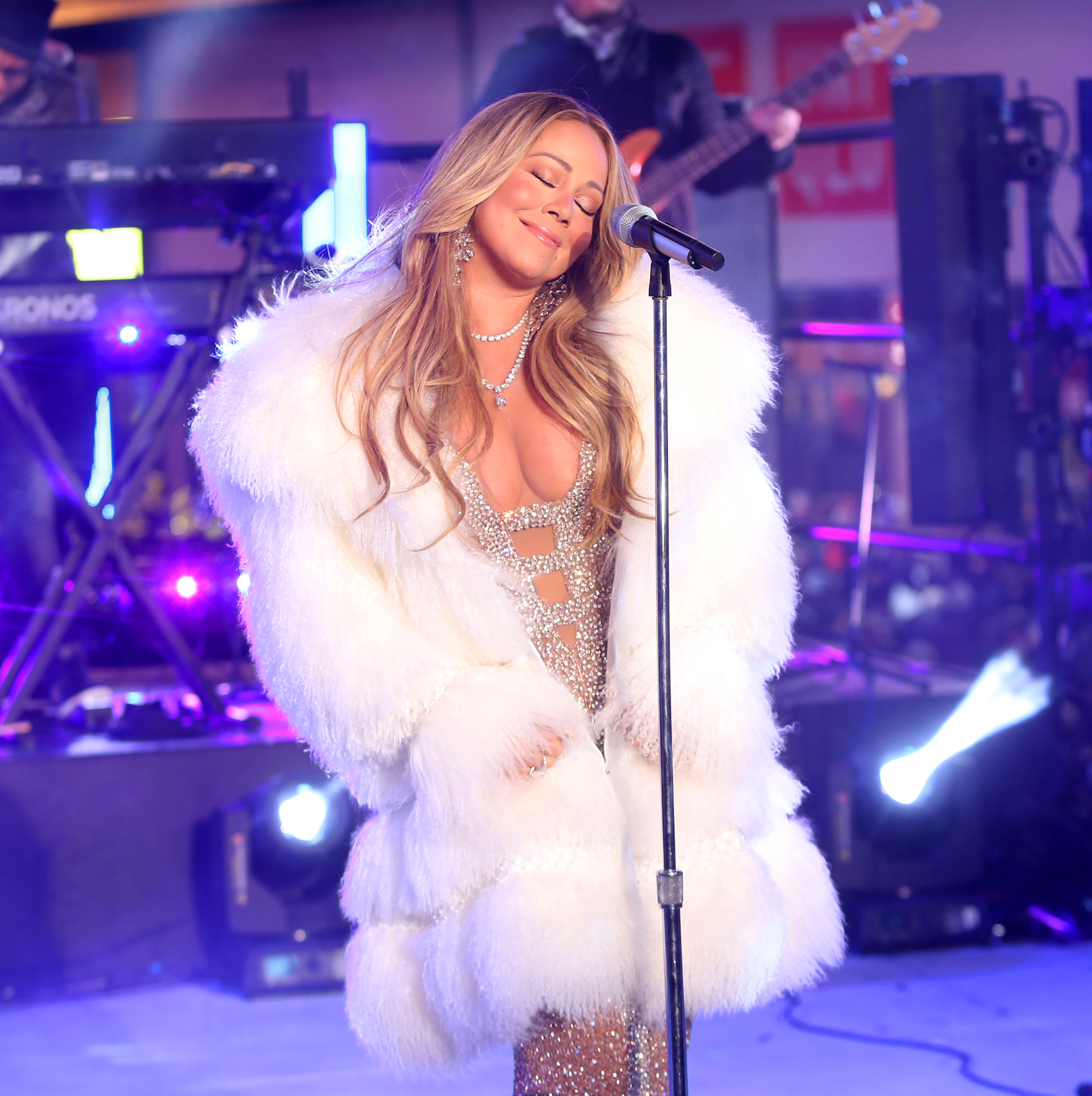 Mariah Carey performs at Dick Clark's New Year's Rockin' Eve in NYC <P> Pictured: Mariah Carey <B>Ref: SPL1638729  311217  </B><BR/> Picture by: Richard Buxo / Splash News<BR/> </P><P> <B>Splash News and Pictures</B><BR/> Los Angeles:310-821-2666<BR/> New York:212-619-2666<BR/> London:870-934-2666<BR/> <span id=