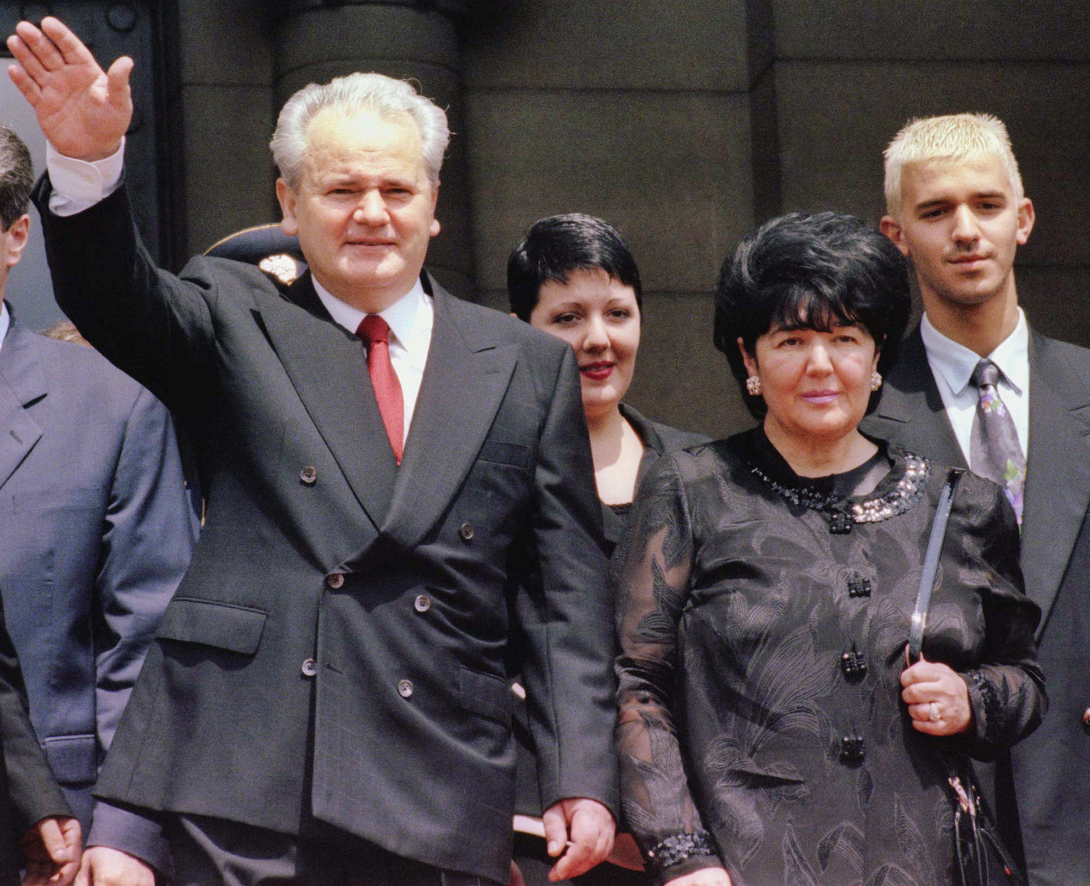 Former Yugoslav president Slobodan Milosevic (L) waves to supporters while standing with his daughter Marija (2nd L), wife and coalition partner Mira Markovic (2nd R) and son Marko after the inauguration ceremony in Belgrade in this July 23, 1997 file photo. Milosevic has died, the UN tribunal said on March 11, 2006, just months before his war crimes trial was expected to conclude.