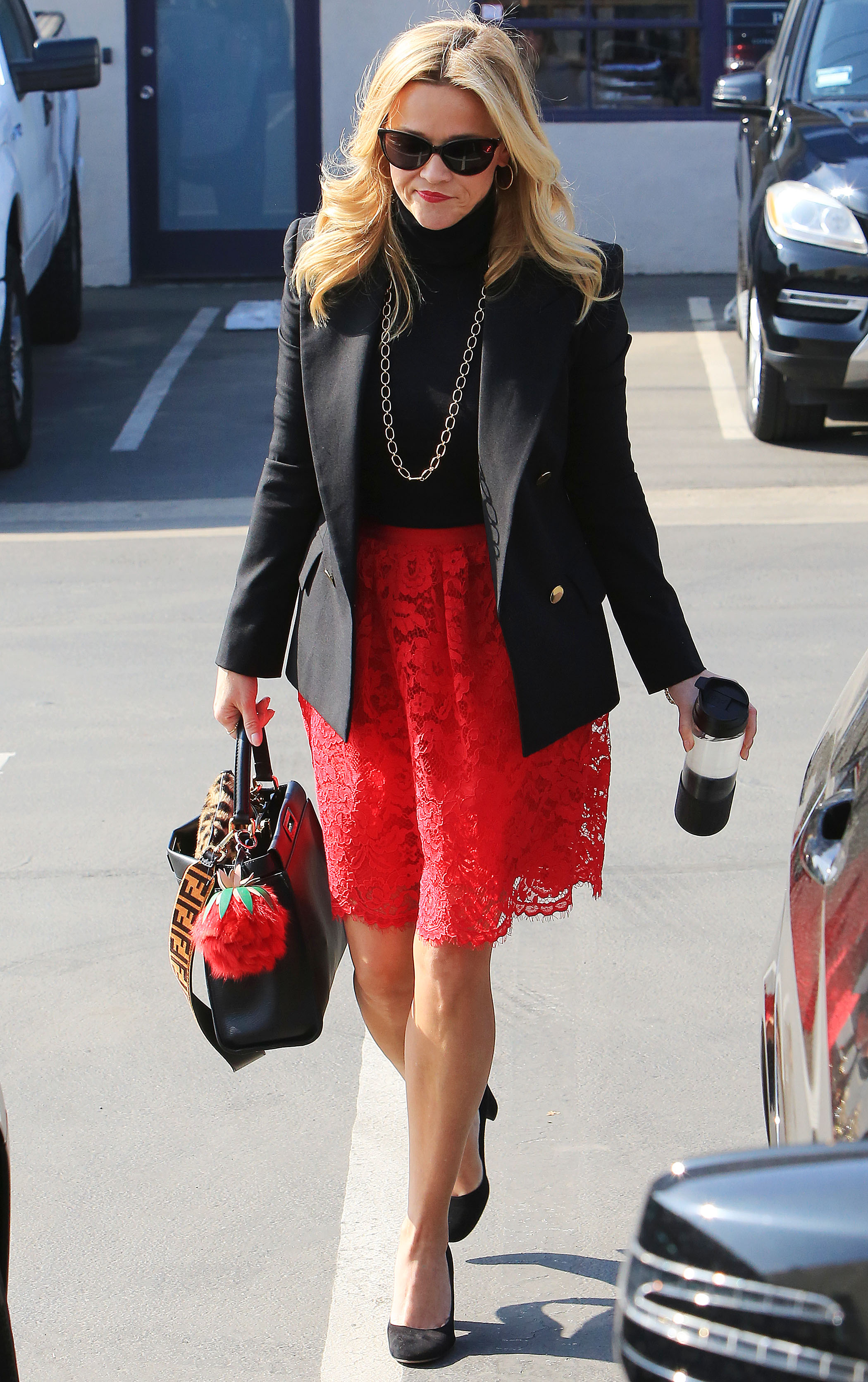 NO JUST JARED USAGE<BR/> Reese Witherspoon teams black turtleneck with eye-popping scarlet skirt as she run errands with her coffee mug in Brentwood <P> Pictured: Reese Witherspoon <B>Ref: SPL1655498  060218  </B><BR/> Picture by: Splash News<BR/> </P><P> <B>Splash News and Pictures</B><BR/> Los Angeles:310-821-2666<BR/> New York:212-619-2666<BR/> London:870-934-2666<BR/> <span id=