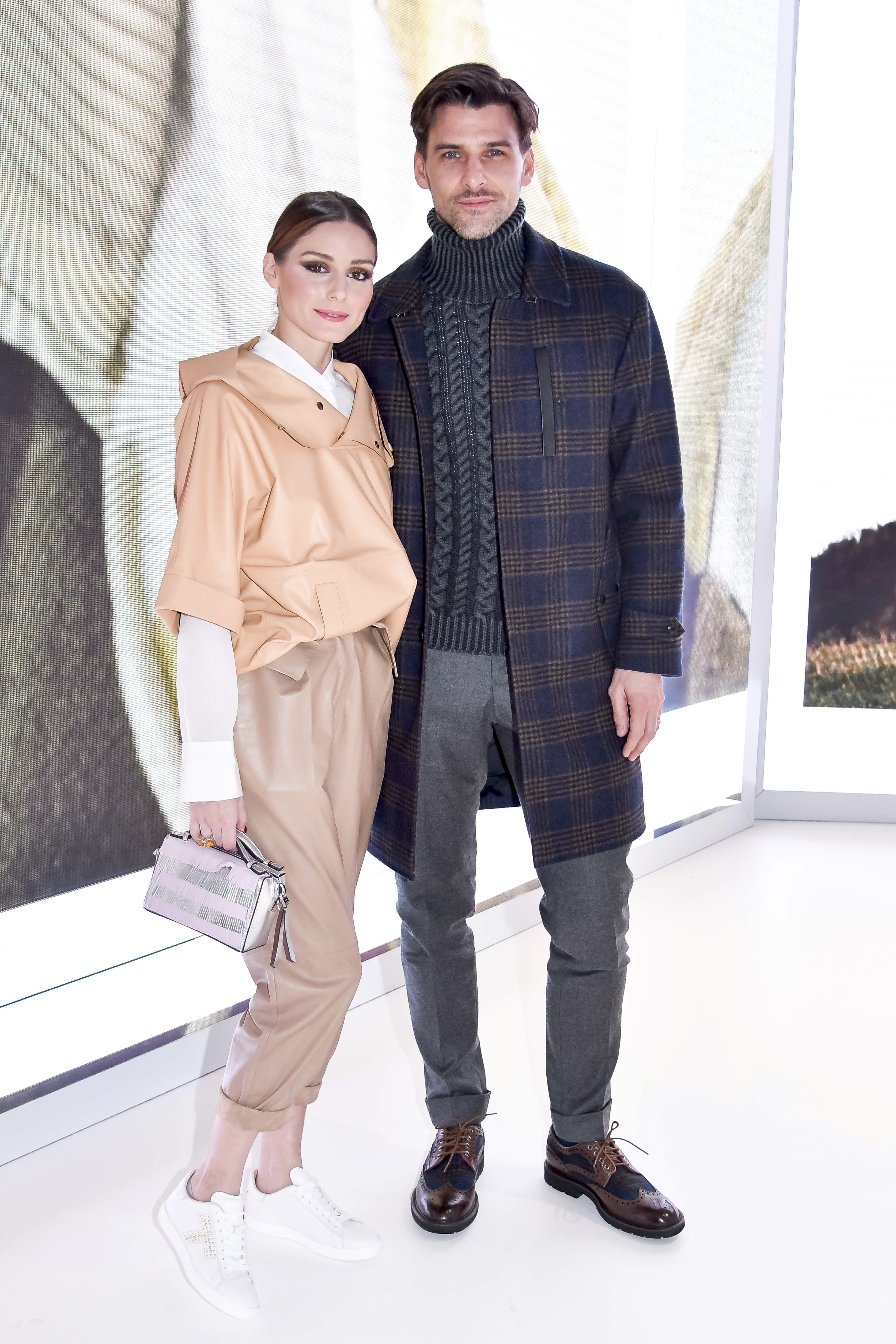 Olivia Palermo and Johannes Huebl pose for a quick photo before sitting front row for the Tod's Ready to Wear Fall Winter 2018 Fashion Show in Milan. February 23, 2018 X17online.com USA ONLY