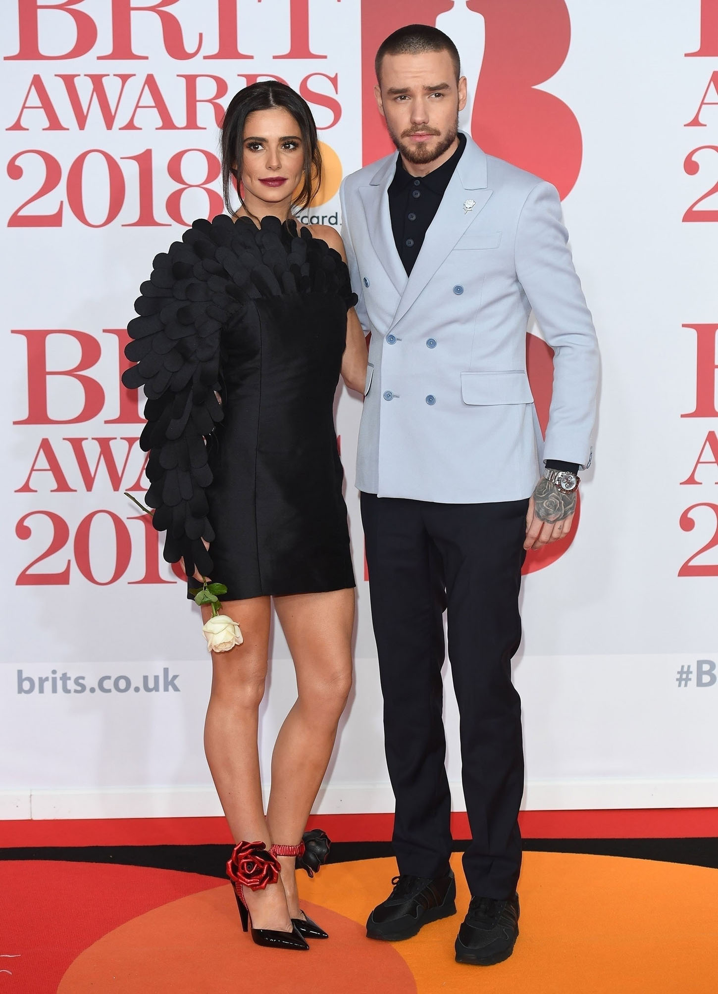 BGUK_1150824 - London, UNITED KINGDOM  - Cheryl and Liam Payne attend the 2018 Brit Awards. Cheryl held a single white rose as a sign of affection from Liam despite reports of the couple's relationship on the rocks.  Pictured: Cheryl and Liam Payne  BACKGRID UK 22 FEBRUARY 2018, Image: 364011226, License: Rights-managed, Restrictions: , Model Release: no, Credit line: Profimedia, Xposurephotos