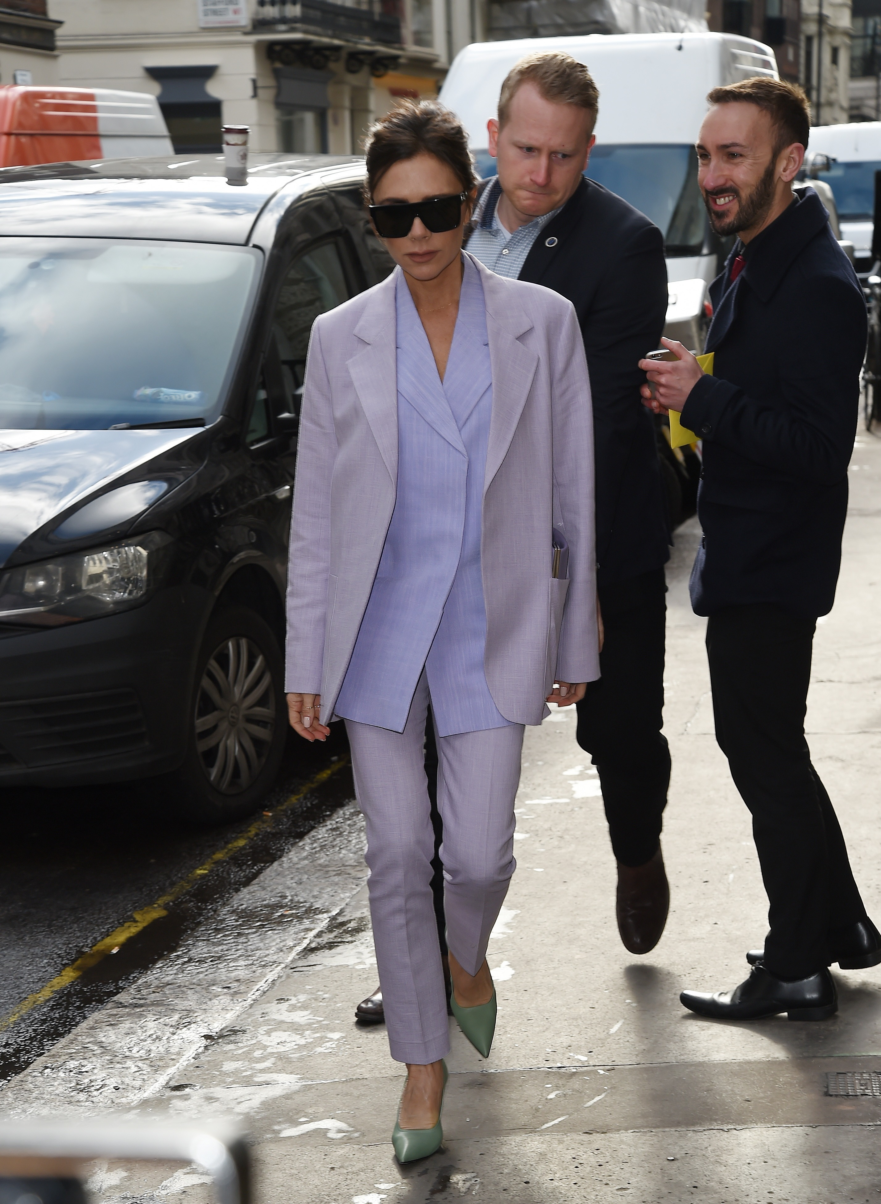Victoria Beckham is seen in the streets of London, UK. Posh Spice is known to be incredibly stylish, but she misses the mark in this purple number, which looks a bit like a nurse's uniform, pairing it with off-green high heels.  <P> Pictured: Victoria Beckham <B>Ref: SPL1669120  080318  </B><BR/> Picture by: Flynet - Splash News<BR/> </P><P> <B>Splash News and Pictures</B><BR/> Los Angeles:310-821-2666<BR/> New York:212-619-2666<BR/> London:870-934-2666<BR/> <span id=