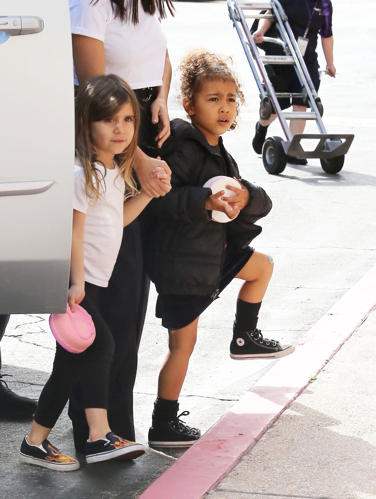 Wednesday, March 14, 2018 - Adorable Nori West spends quality time with Aunt Kourtney Kardashian and cousin Penelope Disick while parents Kim Kardashian and Kanye West are vacationing in Wyoming. North is adorable in a black puffer coat and black dress paired with kiddie Chuck Taylors, and is showing a bandaged knee. Daddy/X17online.com