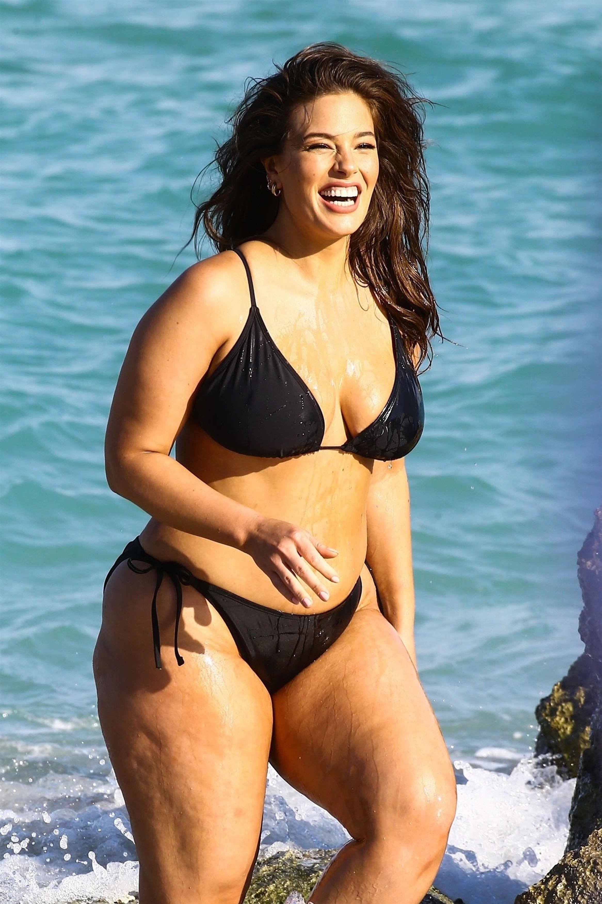 Miami, FL  - Model Ashley Graham is seen doing a sexy photoshoot on the beach in Miami. Ashley showed off her curves in a black bikini during the photoshoot.  Pictured: Ashley Graham    *UK Clients - Pictures Containing Children Please Pixelate Face Prior To Publication*, Image: 366040304, License: Rights-managed, Restrictions: , Model Release: no, Credit line: Profimedia, AKM-GSI