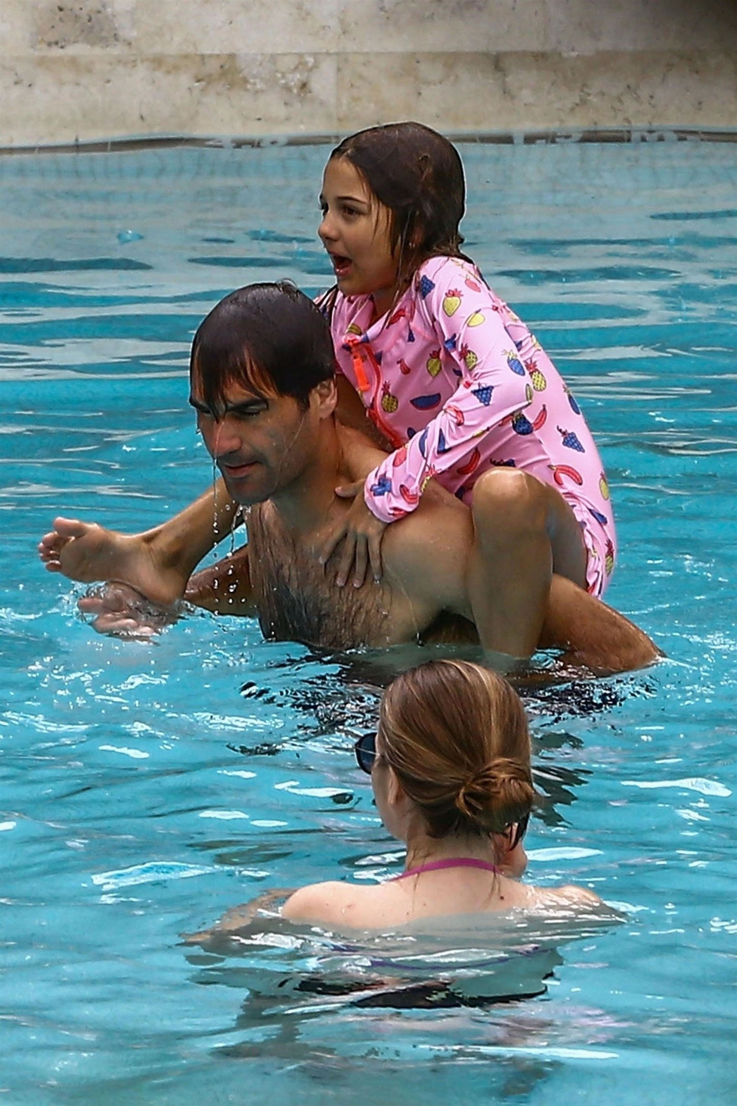 Miami, FL  - *EXCLUSIVE*  - World ranked #1 tennis player Roger Federer and his wife Mirka enjoy a day at the pool with their kids Myla, Charlene, Leo and Lenny in Miami. Roger had fun splashing around with his kids while Mirka just relaxed in the pool.  Pictured: Roger Federer, Mirka Federer, Myla Federer, Charlene Federer  BACKGRID USA 21 MARCH 2018, Image: 366600906, License: Rights-managed, Restrictions: , Model Release: no, Credit line: Profimedia, AKM-GSI