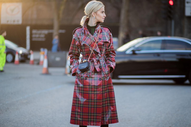 LONDON, ENGLAND - FEBRUARY 17: Caroline Daur wearing red plaid coat seen outside Burberry, black mini bag during London Fashion Week February 2018 on February 17, 2018 in London, England. (Photo by Christian Vierig/Getty Images)