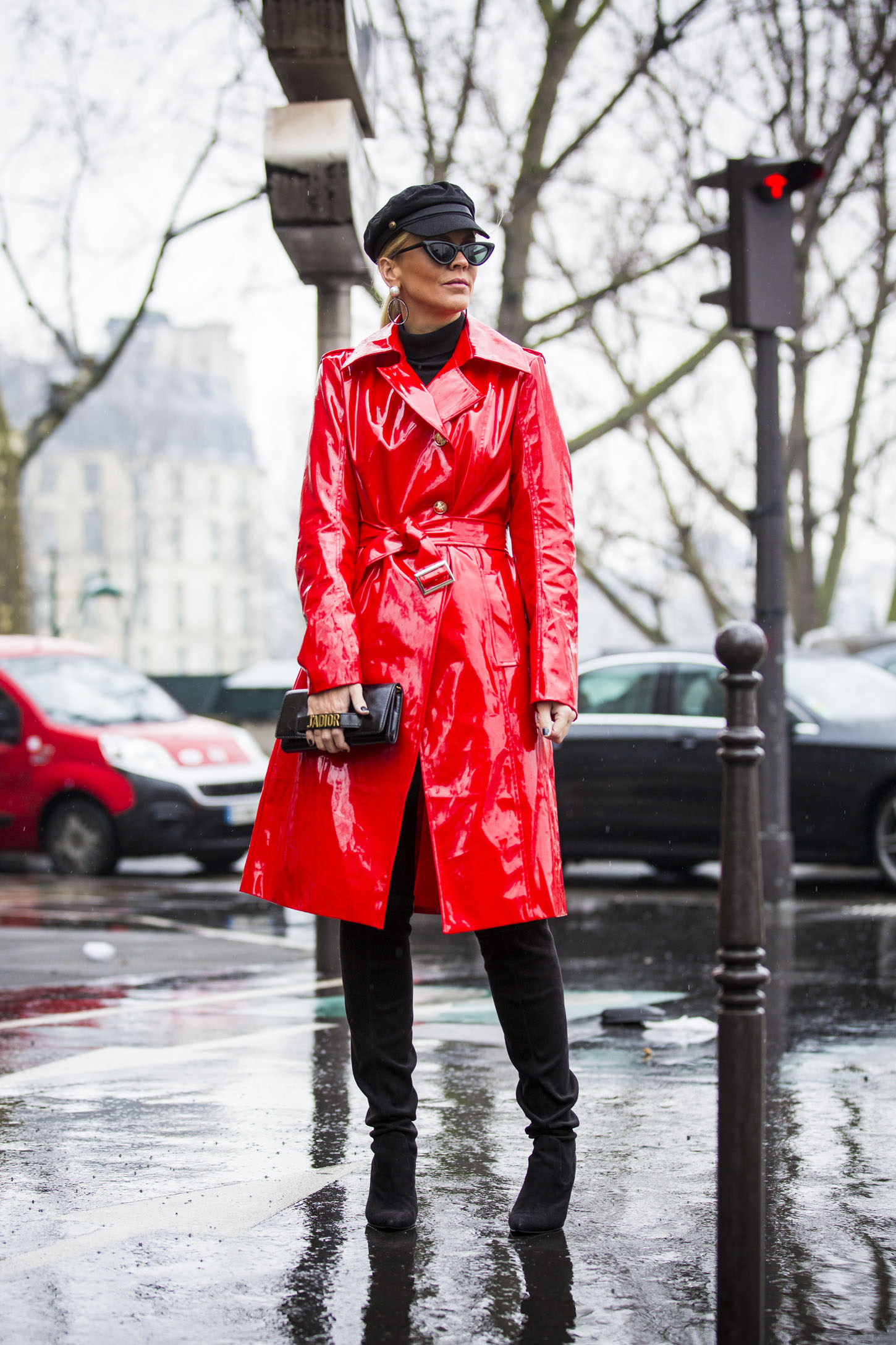 PARIS, FRANCE - MARCH 02:  Lorena Campello, wearing red laminated trench coat and Dior bag, is seen in the streets of Paris before the Balmain show during Paris Fashion Week Womenswear Fall/Winter 2018/2019 on March 2, 2018 in Paris, France. (Photo by Claudio Lavenia/Getty Images)