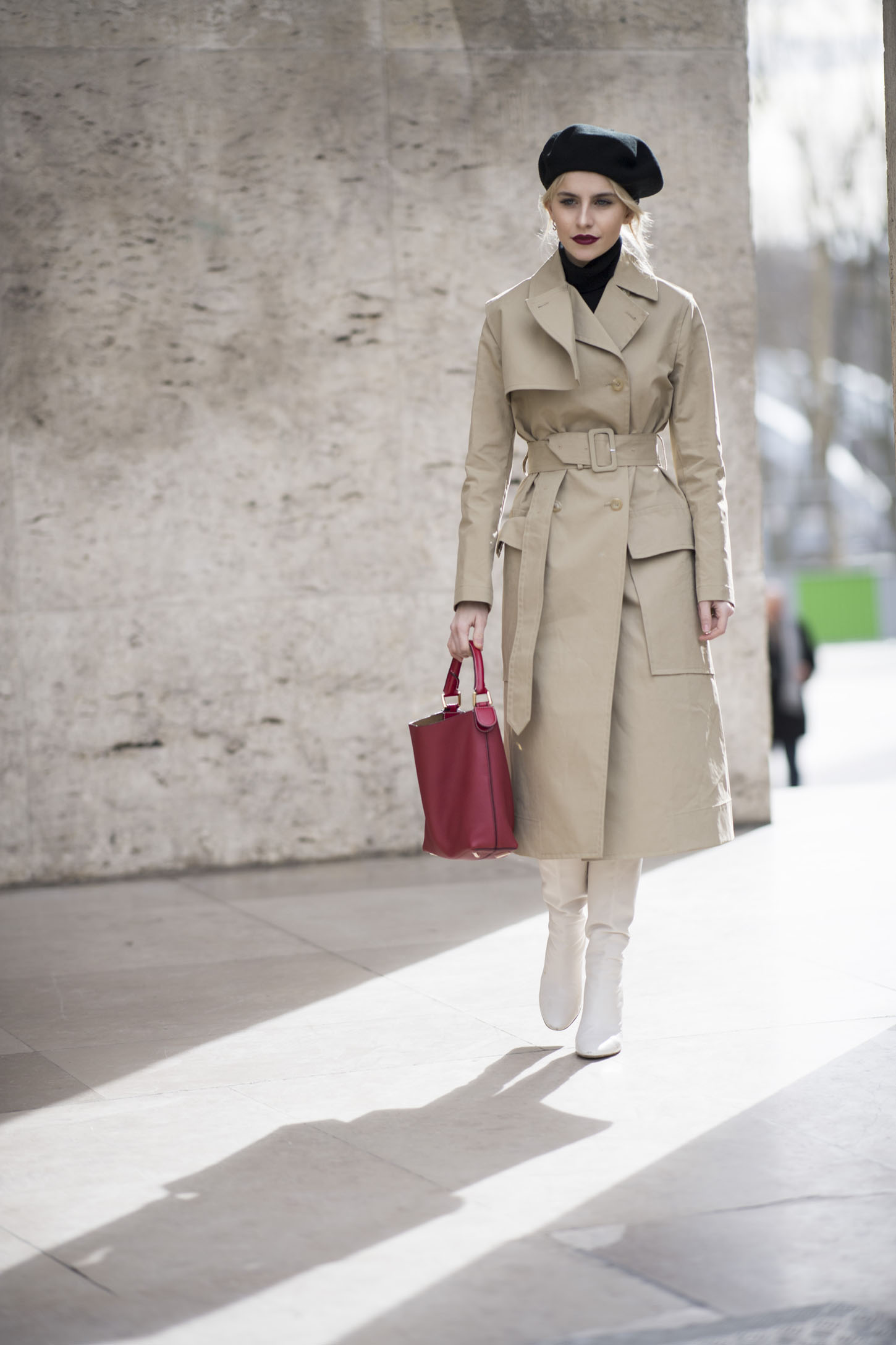 PARIS, FRANCE - MARCH 05: Caro Daur seen wearing a beige trenchcoat and a red bag from Loewe in the streets of Paris during the Paris Fashion Week Womenswear Fall/Winter 2018/2019 on March 5, 2018 in Paris, France.  (Photo by Timur Emek/Getty Images)