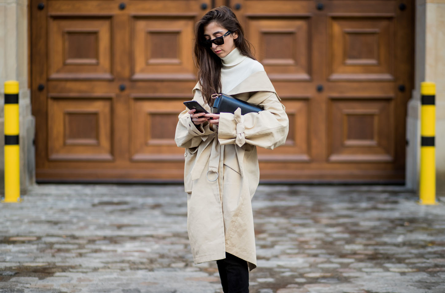 BERLIN, GERMANY - MARCH 08:  Nadja Ali wearing trench coat &other stories, overknee boots Mango, Uniqlo turtleneck, Celine sunnies, bag Liebeskind is seen on March 8, 2018 in Berlin, Germany. (Photo by Christian Vierig/Getty Images)