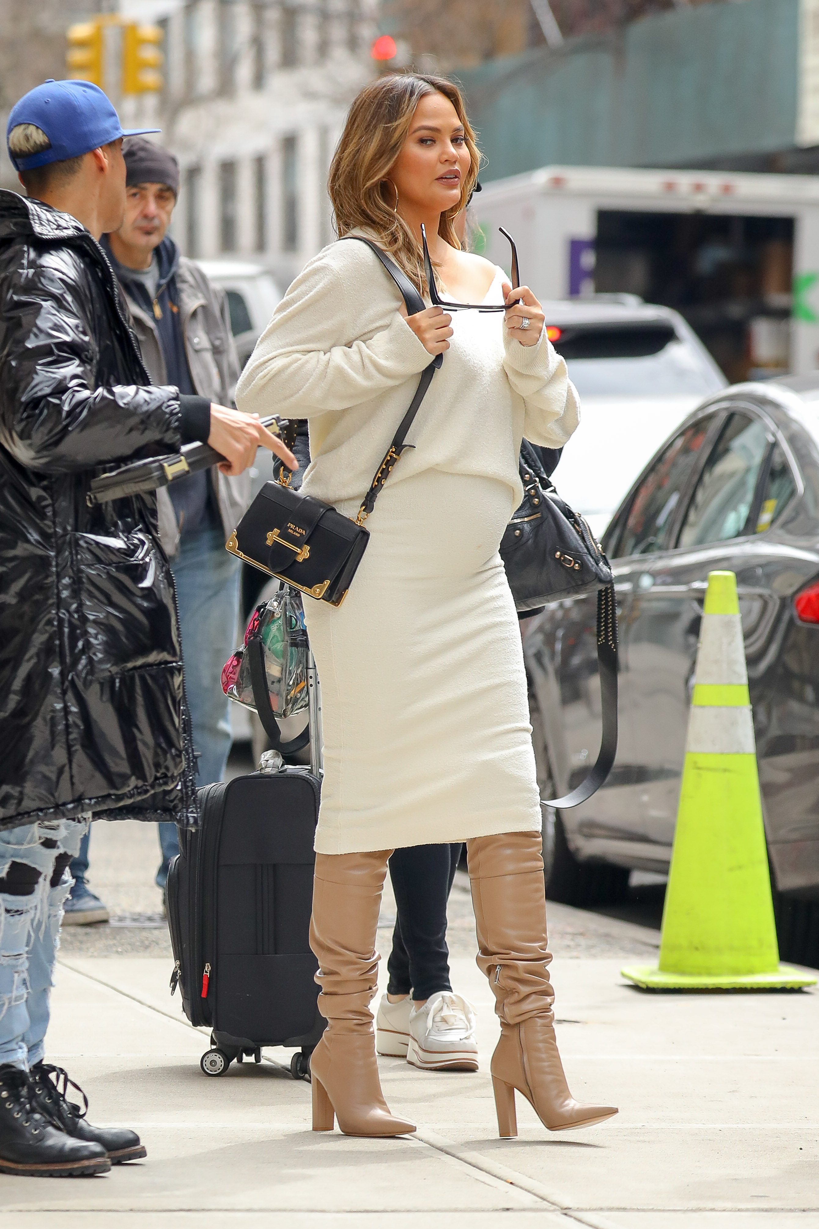 EXCLUSIVE: Chrissy Teigen wore display her belly in white outfit while out and about in New York City <P> Pictured: Chrissy Teigen <B>Ref: SPL1676397  270318   EXCLUSIVE</B><BR/> Picture by: Felipe Ramales / Splash News<BR/> </P><P> <B>Splash News and Pictures</B><BR/> Los Angeles:310-821-2666<BR/> New York:212-619-2666<BR/> London:870-934-2666<BR/> <span id=