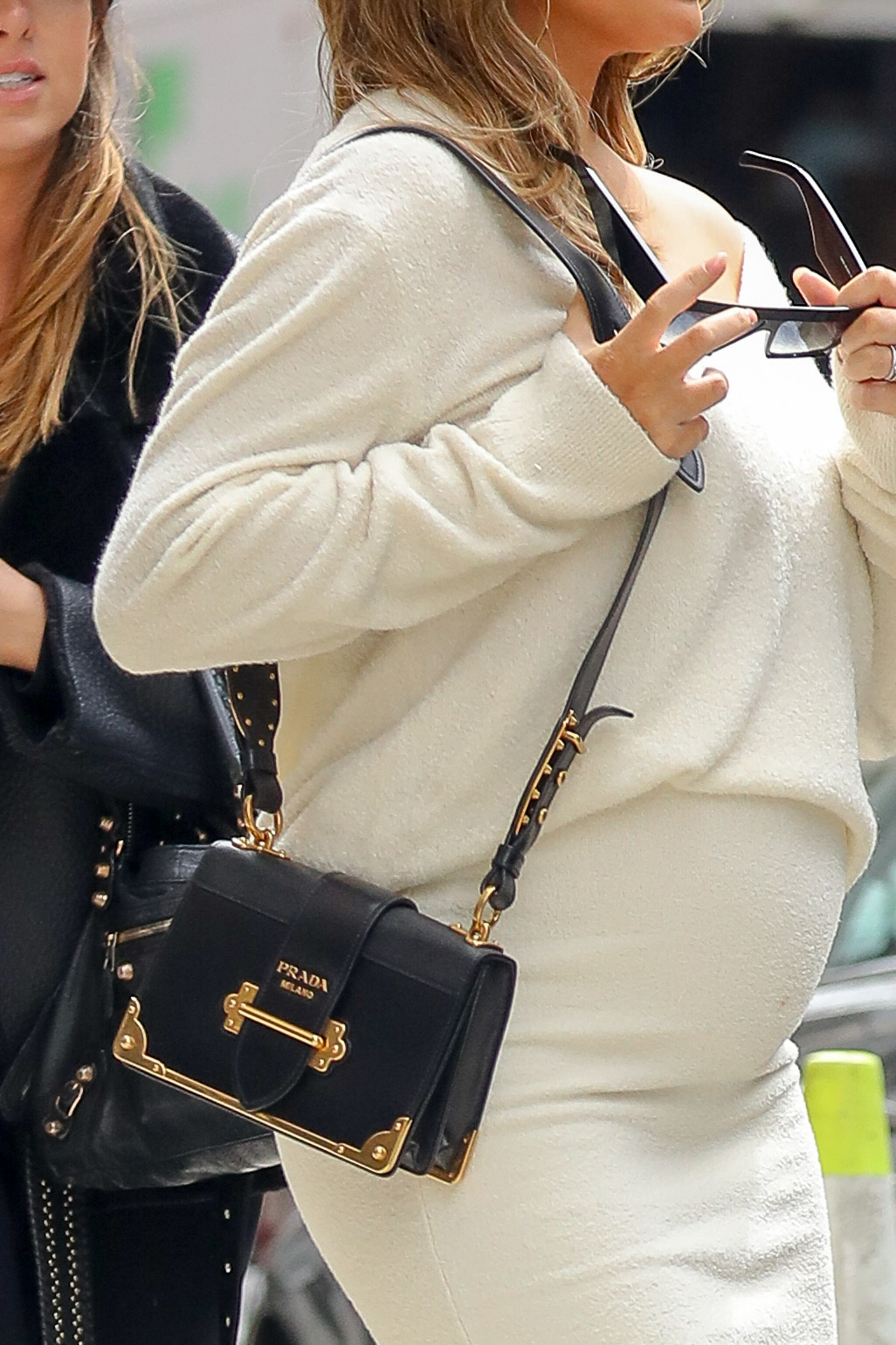 Chrissy Teigen wore display her belly in white outfit while out and about in New York City <P> Pictured: Chrissy Teigen <B>Ref: SPL1676422  270318  </B><BR/> Picture by: Felipe Ramales / Splash News<BR/> </P><P> <B>Splash News and Pictures</B><BR/> Los Angeles:310-821-2666<BR/> New York:212-619-2666<BR/> London:870-934-2666<BR/> <span id=