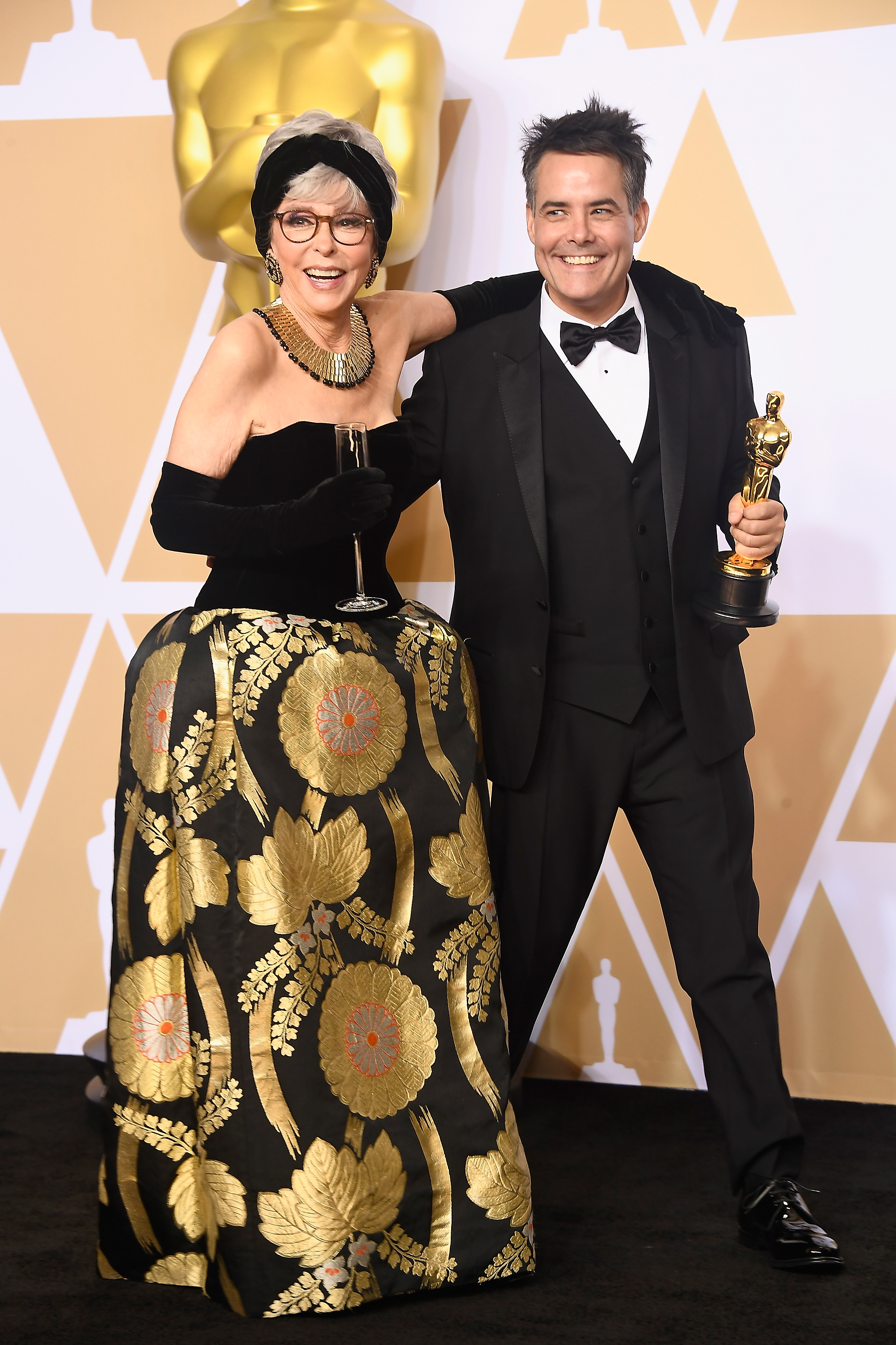 HOLLYWOOD, CA - MARCH 04:  Actor Rita Moreno (L) and director Sebastian Lelio, winner of the Best Foreign Language Film award for 'A Fantastic Woman,' pose in the press room during the 90th Annual Academy Awards at Hollywood & Highland Center on March 4, 2018 in Hollywood, California.  (Photo by Frazer Harrison/Getty Images)