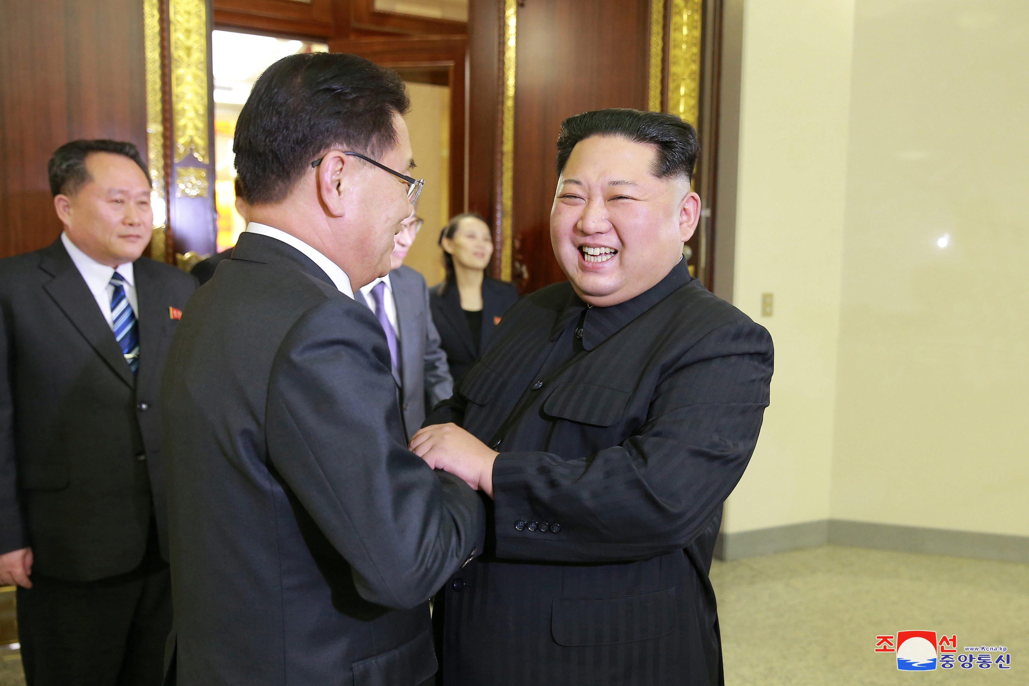 Delegat iz Južne Koreje i Kim Jong-un