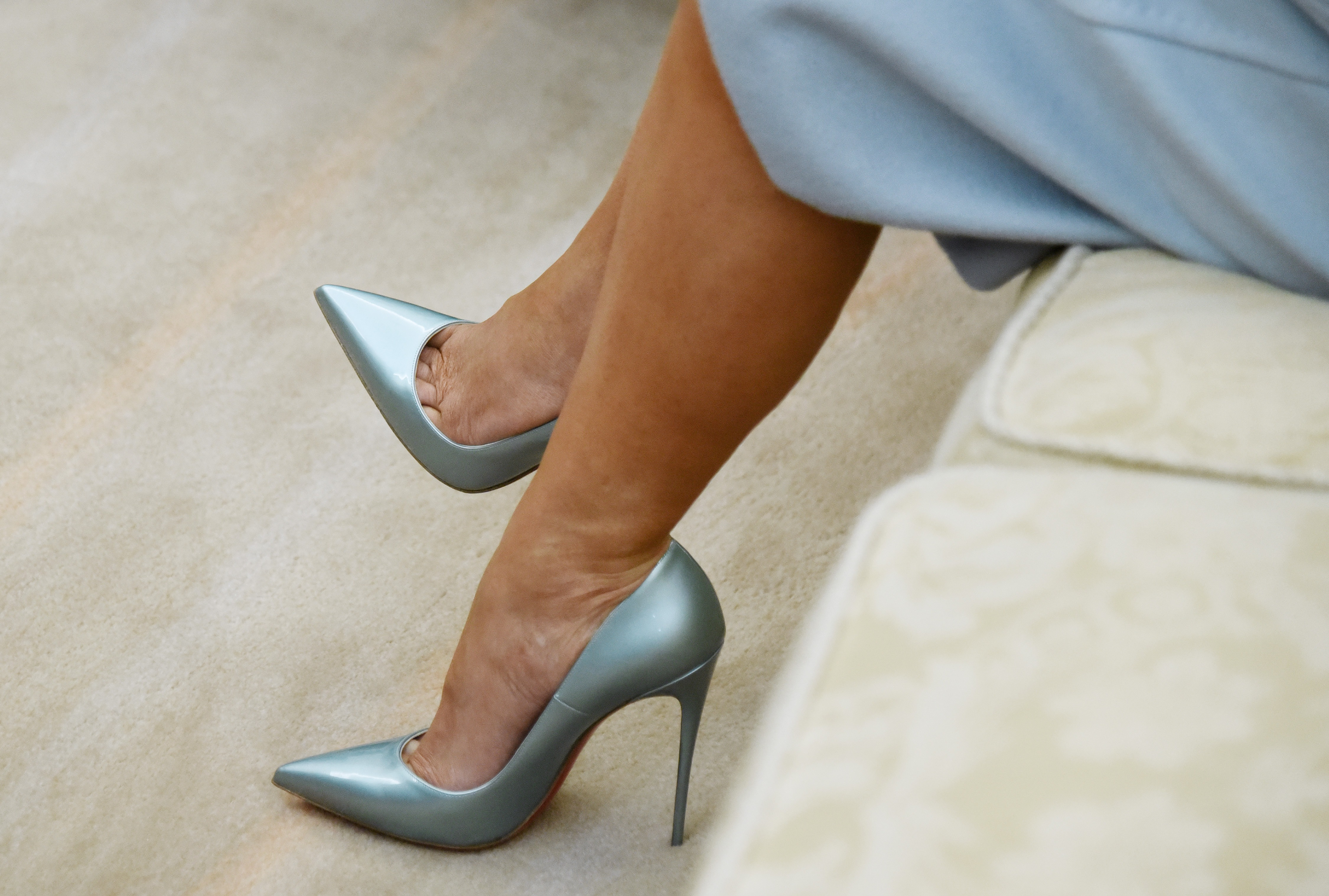 WASHINGTON, DC - MARCH 5: (AFP OUT) A detail of the shoes of First Lady Melania Trump as she attends a meeting with U.S. President Donald Trump and Israel Prime Minister Benjamin Netanyahu in the Oval Office of the White House  March 5, 2018 in Washington, DC. The prime minister is on an official visit to the US until the end of the week. (Photo by Olivier Douliery-Pool/Getty Images)
