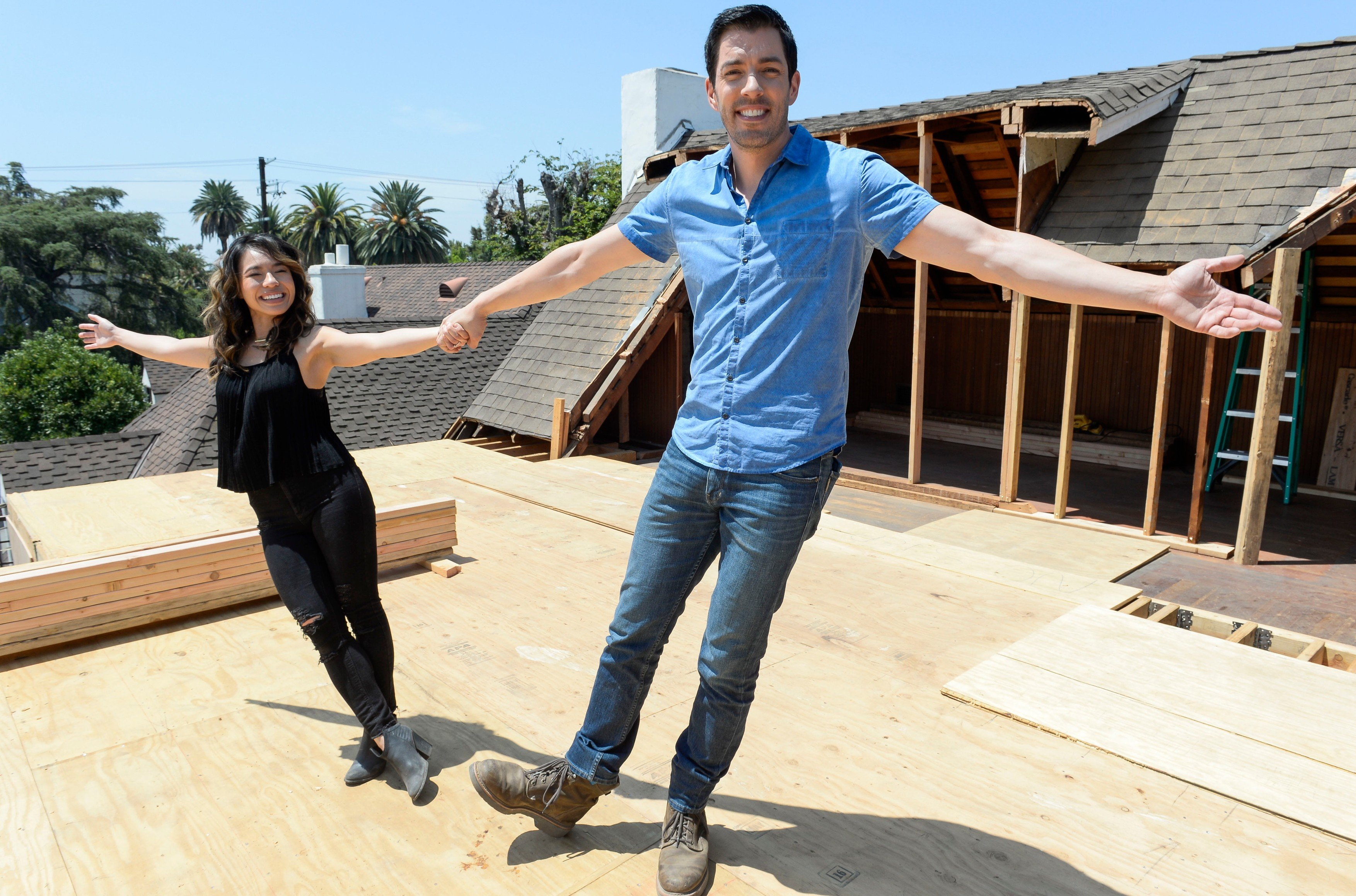 July 19, 2017; Los Angeles, CA, USA; Drew Scott and fiancee Linda Phan during the filming of \