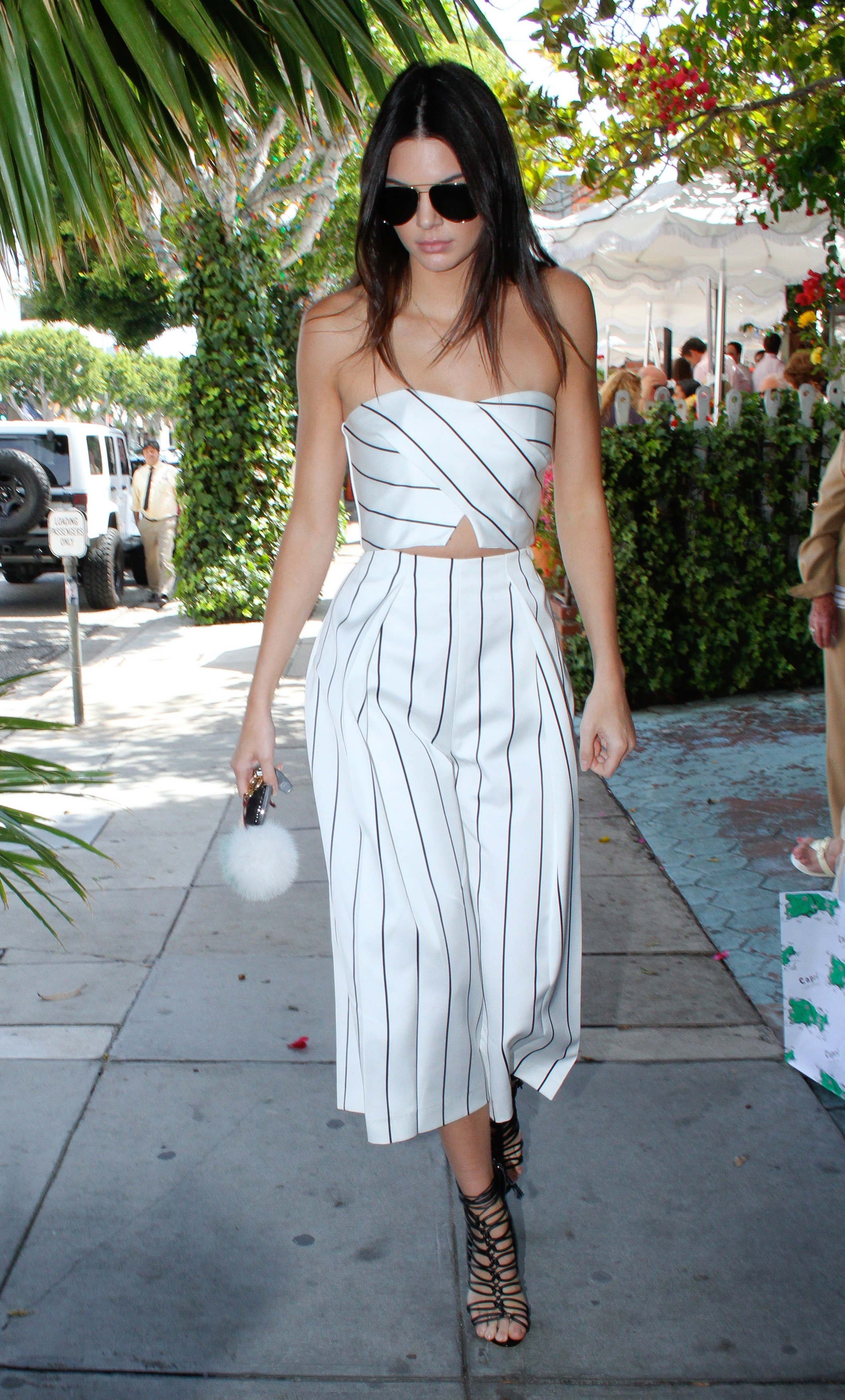 Culver City, CA - Kendall Jenner exits The Ivy after lunch with her mom Kris and sister Khloe, the brunette model wore a black and white striped strapless crop top with matching culottes and Gladiator style black leather heels.          May 11, 2015, Image: 244118340, License: Rights-managed, Restrictions: NO Brazil, Model Release: no, Credit line: Profimedia, AKM-GSI