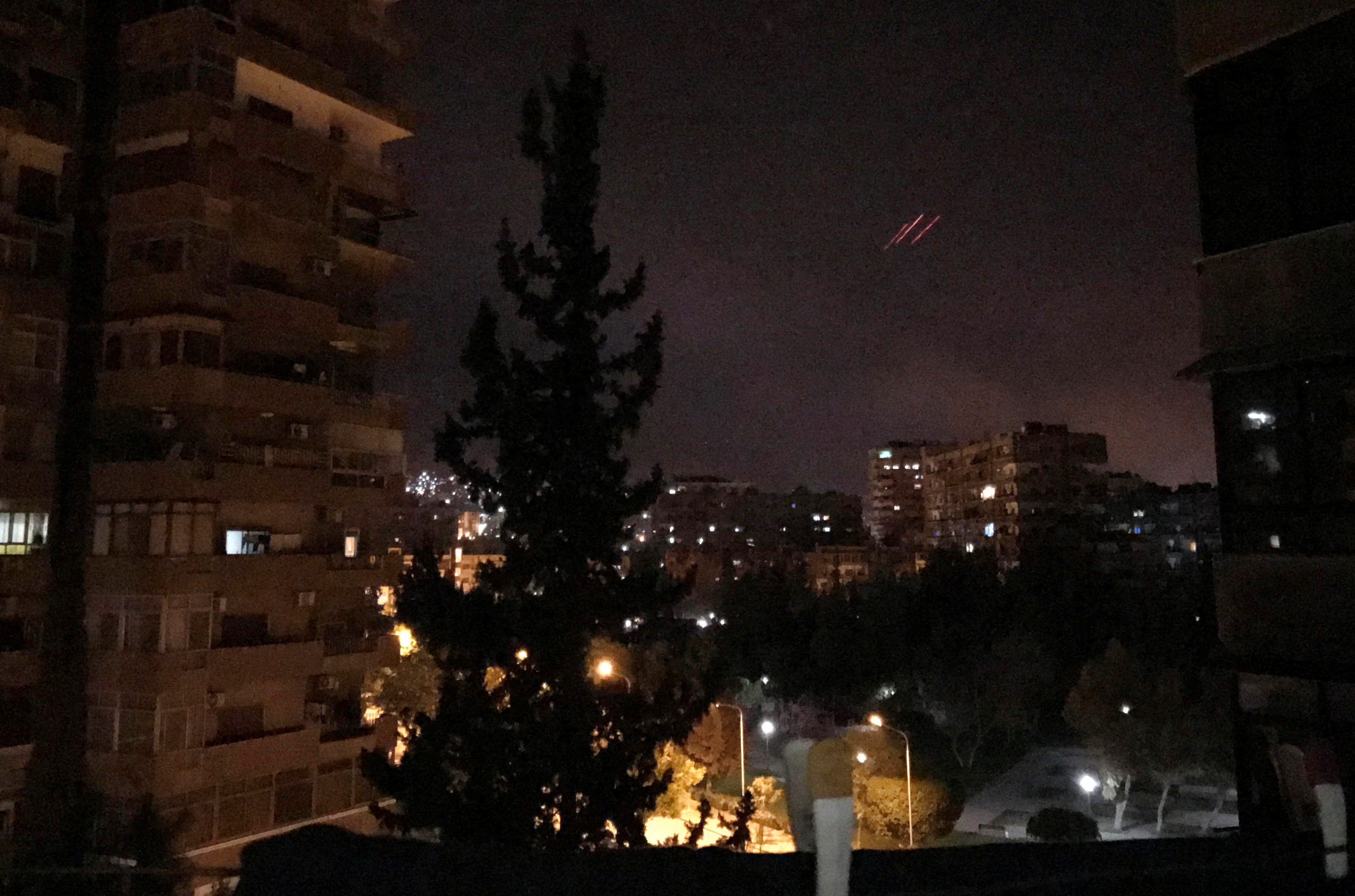 Anti-aircraft fire is seen over Damascus,Syria early April 14, 2018. REUTERS/Feras Makdesi