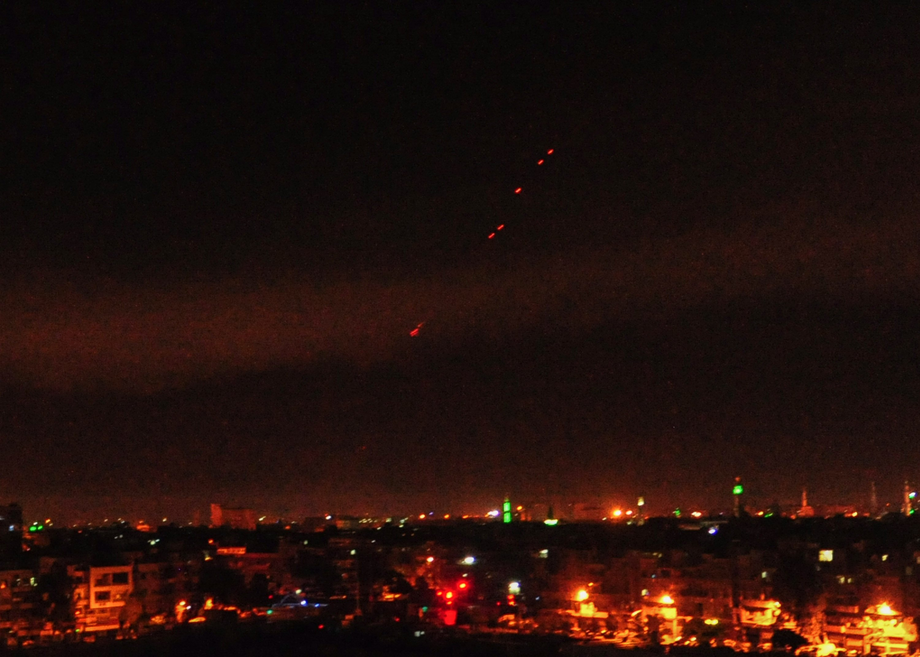 April 14, 2018 - Damascus, Syria - Surface-to-air missiles are seen over Syria's capital Damascus as the Syrian air defenses were responding to U.S. attacks. The U.S. started military actions against Damascus before daybreak Saturday as loud explosions were heard with ''red dots'' seen flying from earth to the sky., Image: 368487683, License: Rights-managed, Restrictions: , Model Release: no, Credit line: Profimedia, Zuma Press - News