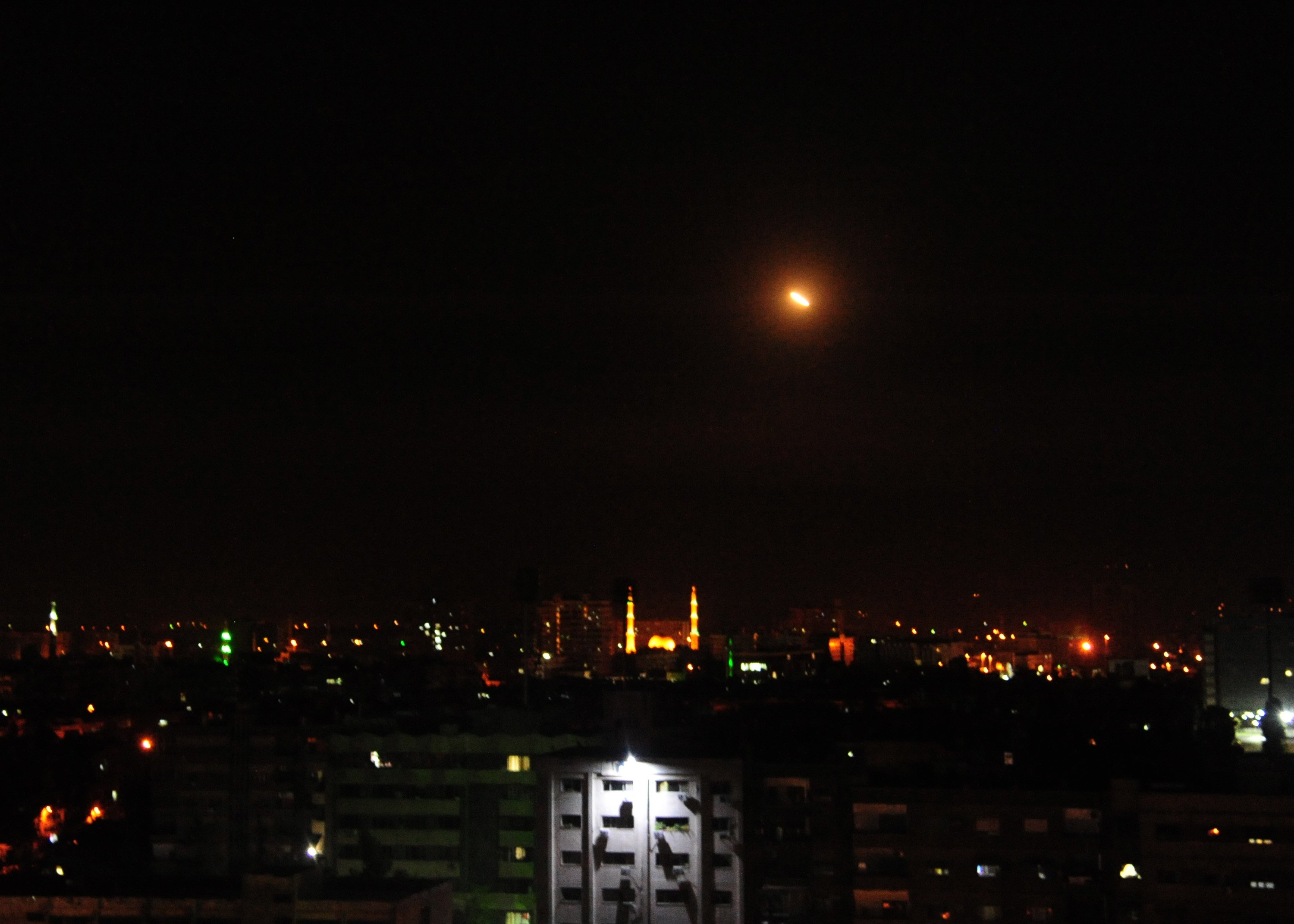 DAMASCUS, April 14, 2018  Surface-to-air missiles are seen over Syria's capital Damascus on April 14, 2018, as the Syrian air defenses were responding to U.S. attacks. The U.S. started military actions against Damascus before daybreak Saturday as loud explosions were heard with ''red dots'' seen flying from earth to the sky, reported Syrian state TV and Xinhua reporters in Damascus.  yy), Image: 368487686, License: Rights-managed, Restrictions: , Model Release: no, Credit line: Profimedia, Zuma Press - News