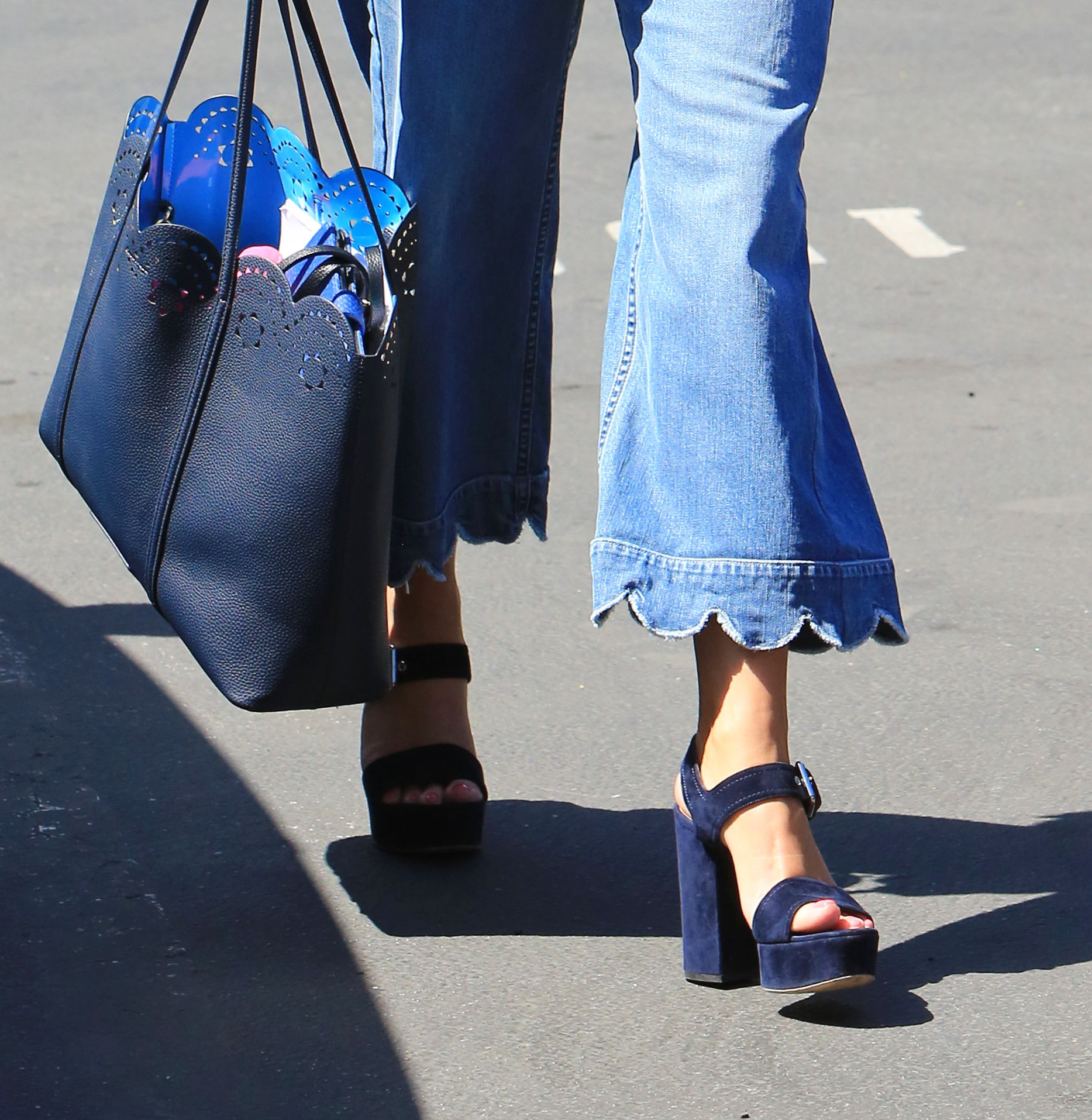 Monday, April 16, 2018 - Reese Withherspoon flashes a smile as she heads into work at the studio Monday morning in Brentwood, CA after filming scenes for Season 2 of her hit show 'Big Little Lies' late last week. Witherspoon looks sharp in a navy blazer, navy pussy bow blows and flared, wide-legged blue jeans, paired with navy heels. -  X17online.com