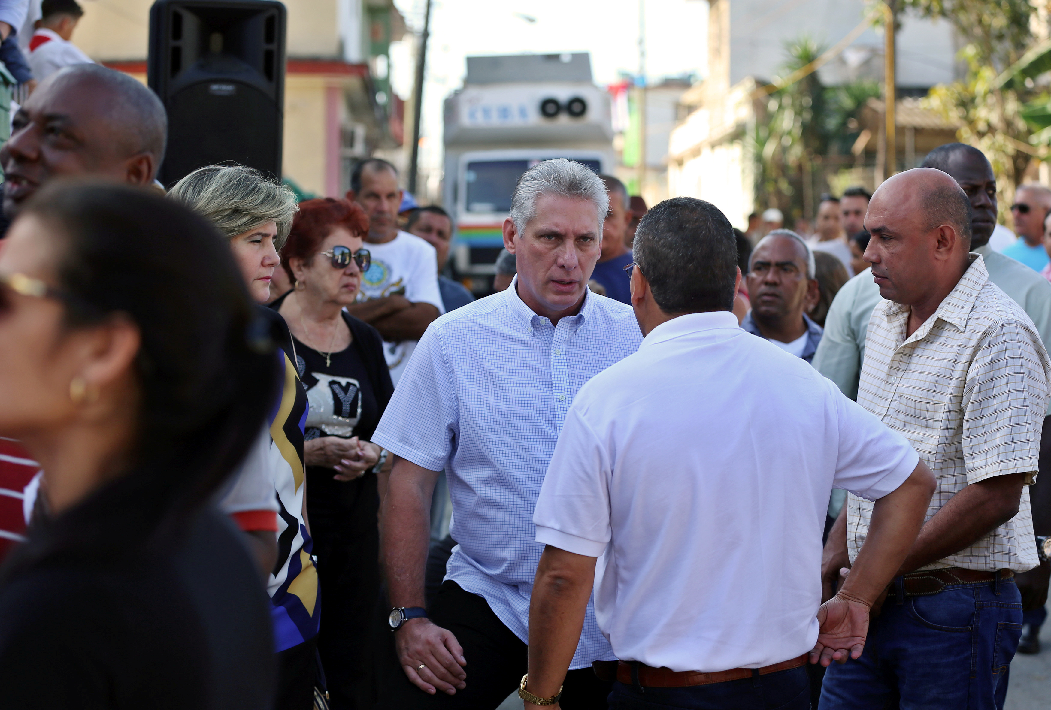 Cuba's First Vice-President Miguel Diaz-Canel talks with local residents before casting his vote during an election of candidates for the national and provincial assemblies, in Santa Clara, Cuba March 11, 2018. REUTERS/Alejandro Ernesto/Pool - RC18D0C254B0