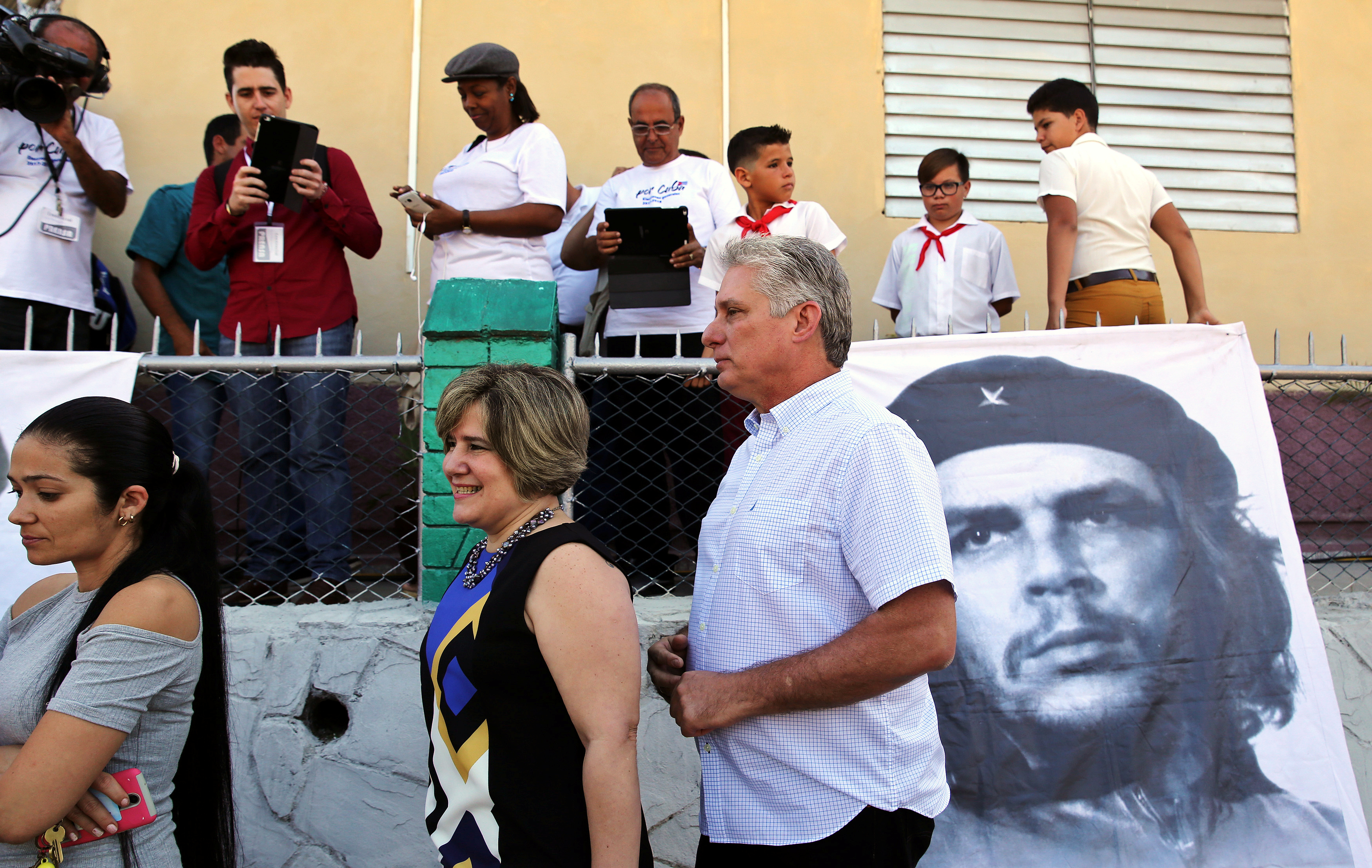 Cuba's First Vice-President Miguel Diaz-Canel and his wife Lis Cuesta stand in line before Diaz-Canel casts his vote during an election of candidates for the national and provincial assemblies, in Santa Clara Cuba March 11, 2018. REUTERS/Alejandro Ernesto/Pool - RC18443D7C80