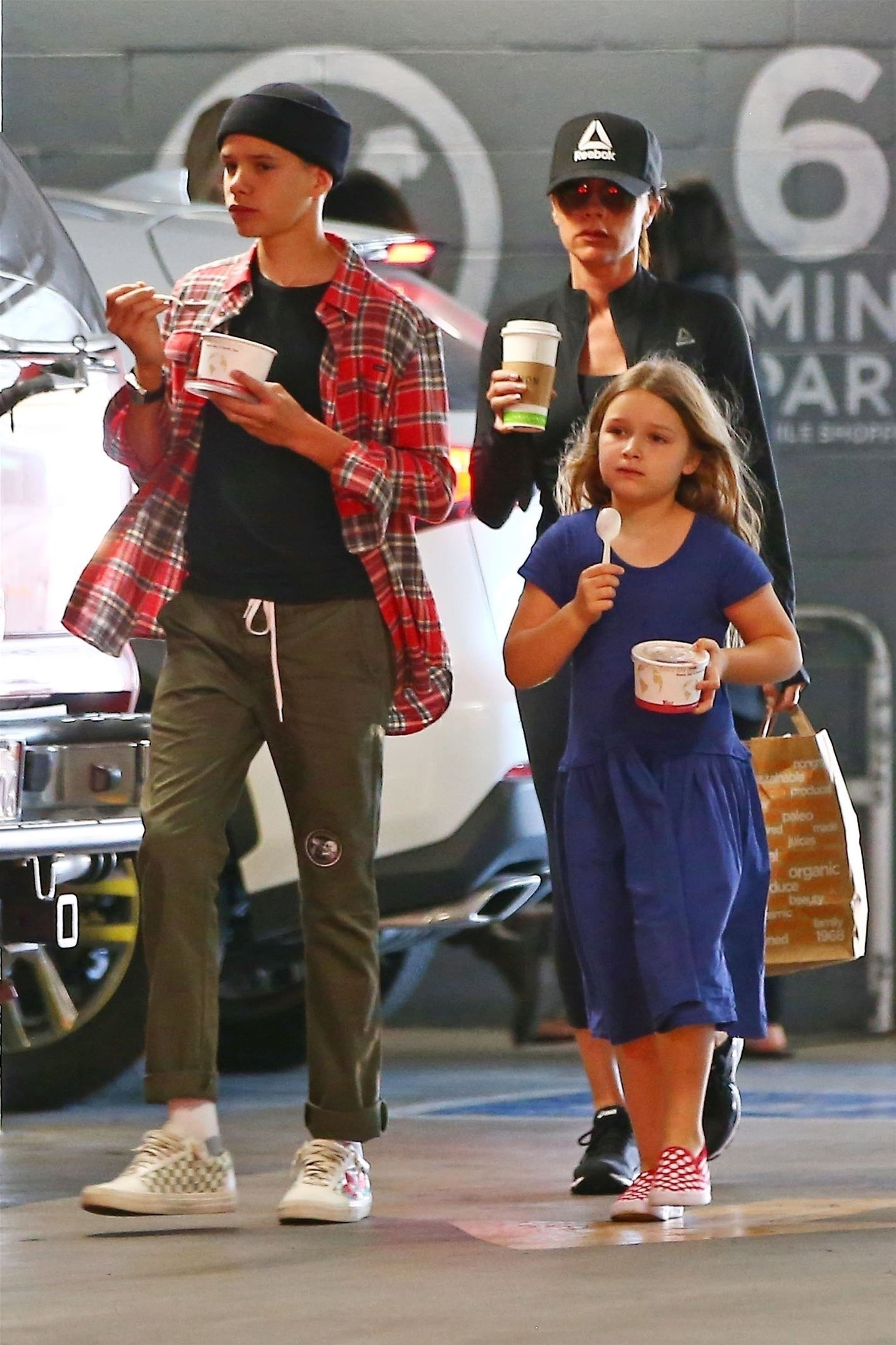 *EXCLUSIVE* ** RIGHTS: WORLDWIDE EXCEPT IN UNITED KINGDOM ** Los Angeles, CA  - Victoria Beckham takes her kids Brooklyn, Romeo, Cruz and Harper grocery shopping at Erewhon in Los Angeles. Victoria, who turned 44 yesterday, was still wearing her black gym outfit as she bought her kids some ice cream. The svelte fashion designer skipped the sweet treat in favor of some coffee.  Pictured: Victoria Beckham, Romeo Beckham, Harper Beckham    *UK Clients - Pictures Containing Children Please Pixelate Face Prior To Publication*, Image: 369056017, License: Rights-managed, Restrictions: , Model Release: no, Credit line: Profimedia, AKM-GSI