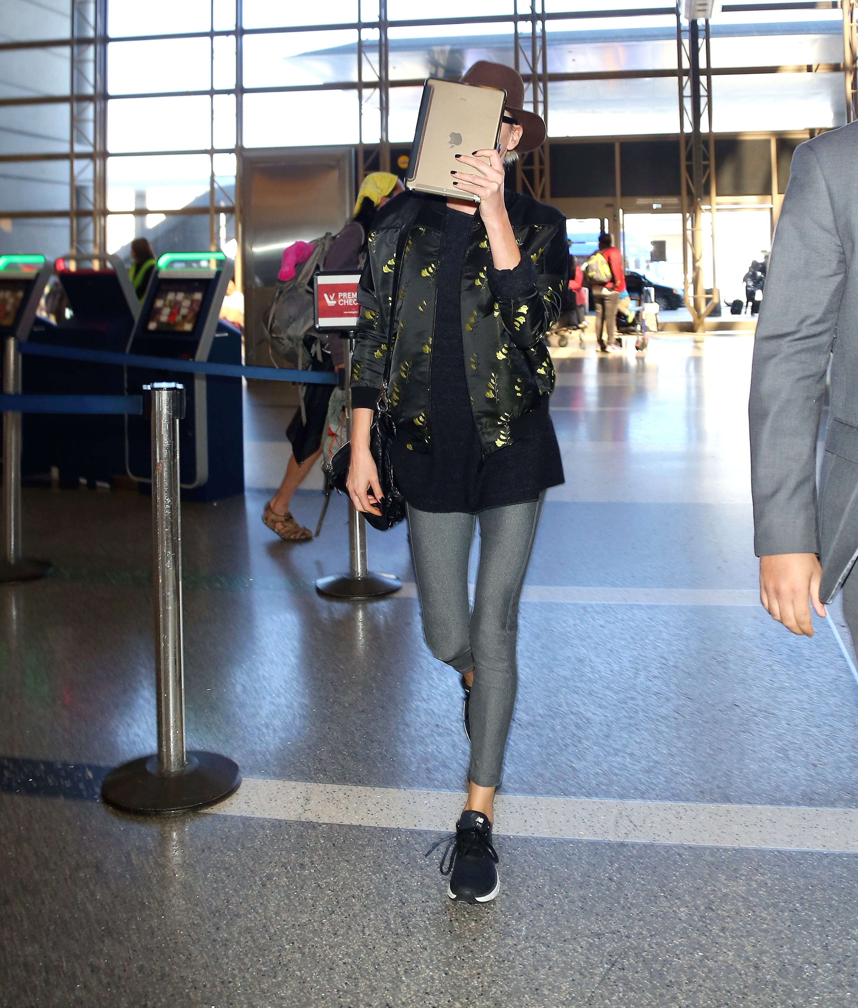PREMIUM EXCLUSIVE Please contact X17 before any use of these exclusive photos - x17@x17agency.com   Charlize Theron arrived at LAX, rocking a cool hat, big sunglasses and a comfy jacket, with tights, catching a flight out of LA, on Thursday, March 15, 2018  Perez/X17online.com  PREMIUM EXCLUSIVE