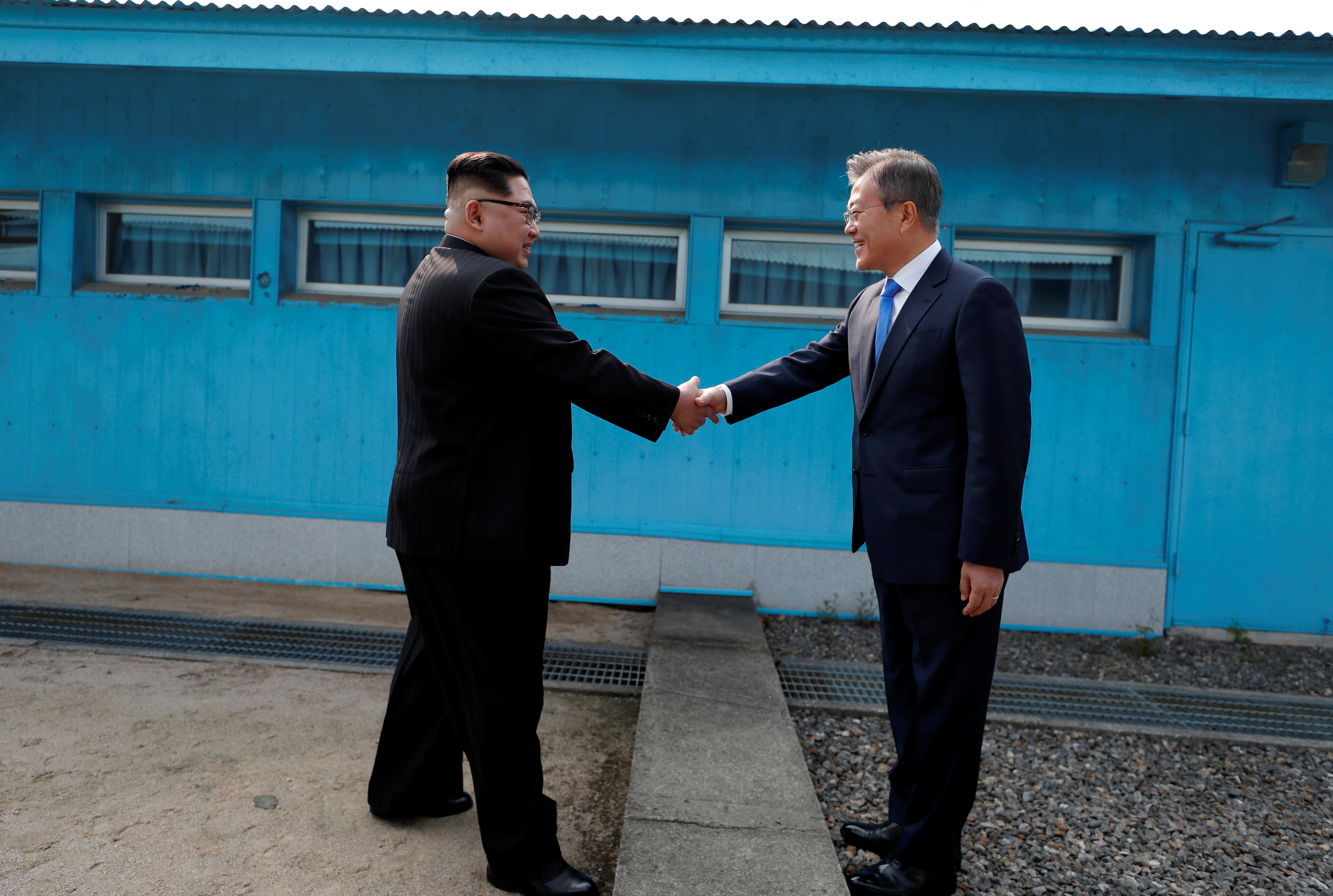 South Korean President Moon Jae-in shakes hands with North Korean leader Kim Jong Un during their meeting at the truce village of Panmunjom inside the demilitarized zone separating the two Koreas, South Korea, April 27, 2018.   Korea Summit Press Pool/Pool via Reuters - RC197FC6AA60