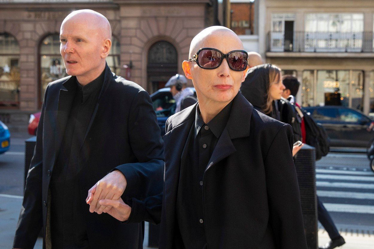 London, UK. Campaigner Christie Elan-Cane (R) arrives at The Royal Courts of Justice for the start of a two-day hearing over gender neutral 'X' passports Gender Neutral Passports court case, The Royal Courts of Justice, London, UK - 18 Apr 2018 Elan-Cane believes the UK's passport application process, which requires individuals to indicate whether they are male or female, is discriminatory., Image: 368841879, License: Rights-managed, Restrictions: , Model Release: no, Credit line: Profimedia, TEMP Rex Features