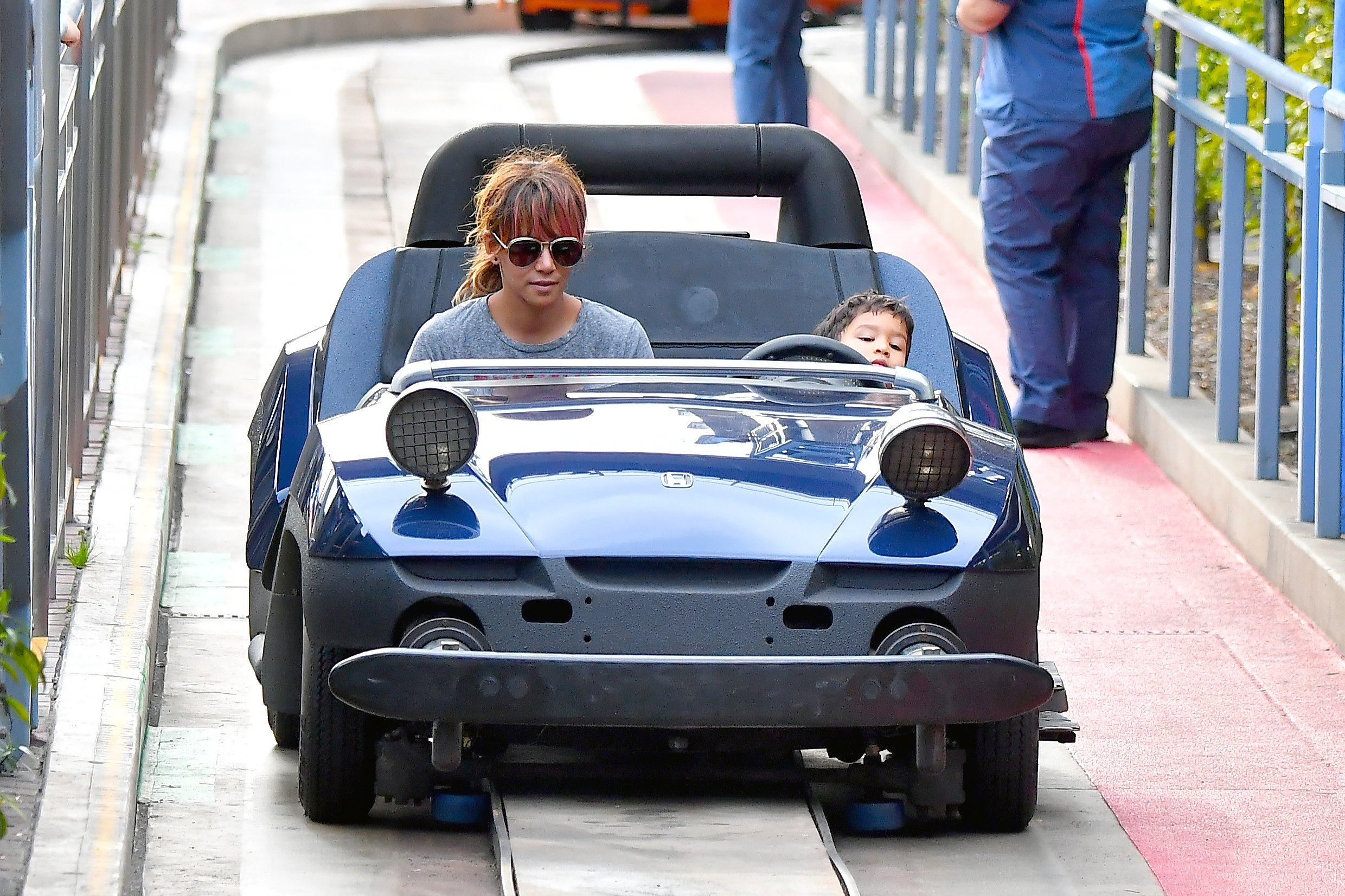 ** PREMIUM EXCLUSIVE RATES APPLY ** Halle Berry lets her son Maceo take the wheel on the Autopia ride at Disneyland as she enjoys a day with her kids at the happiest place on earth. Halle was seen enjoy many of the park's attractions at disneyland including rides in fantasyland, and Tomorrowland. Maceo was seen really enjoying a ride on the Autopia ride, steering them through the ride. Nahla was seen riding alone and spending times with friends that also came along for the Easter Weekend trip.  Halle Sported a red dye job on her bangs and wore no make up to the theme park  ***SPECIAL INSTRUCTIONS*** Please pixelate children's faces before publication.***. 01 Apr 2018, Image: 367569137, License: Rights-managed, Restrictions: World Rights, Model Release: no, Credit line: Profimedia, Mega Agency