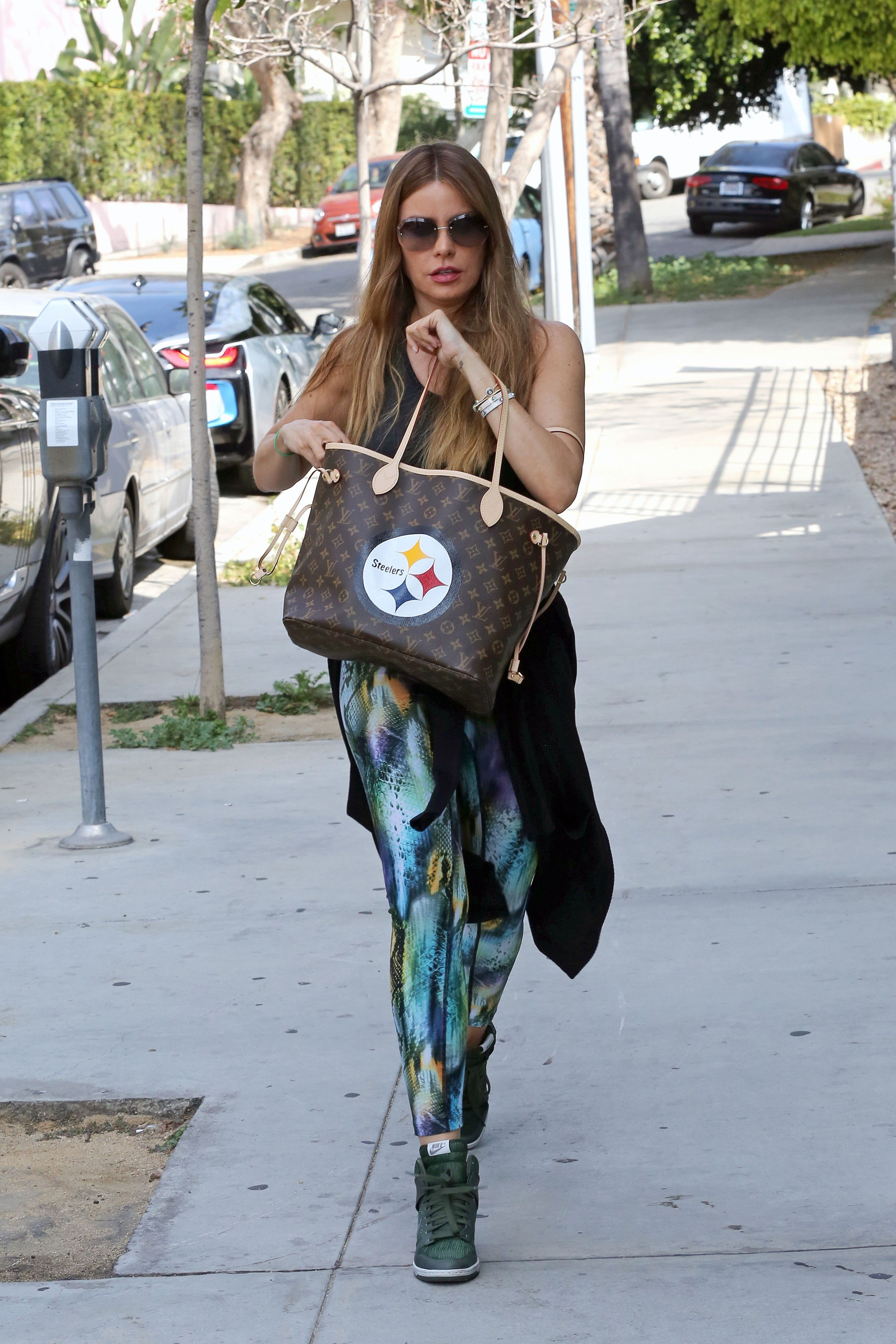EXCLUSIVE: Sofia Vergara is seen out running errands in her gym clothes following the news of her hiring a private investigator to look in to her ex fiancé Nick Loeb. The actress and her ex have been locked in a legal battle over embryos since 2015.  Sofia was sporting a custom made Pittsburgh Steelers Louis Vuitton bag and a colorful pair of leggings. 28 Apr 2018, Image: 370036352, License: Rights-managed, Restrictions: World Rights, Model Release: no, Credit line: Profimedia, Mega Agency