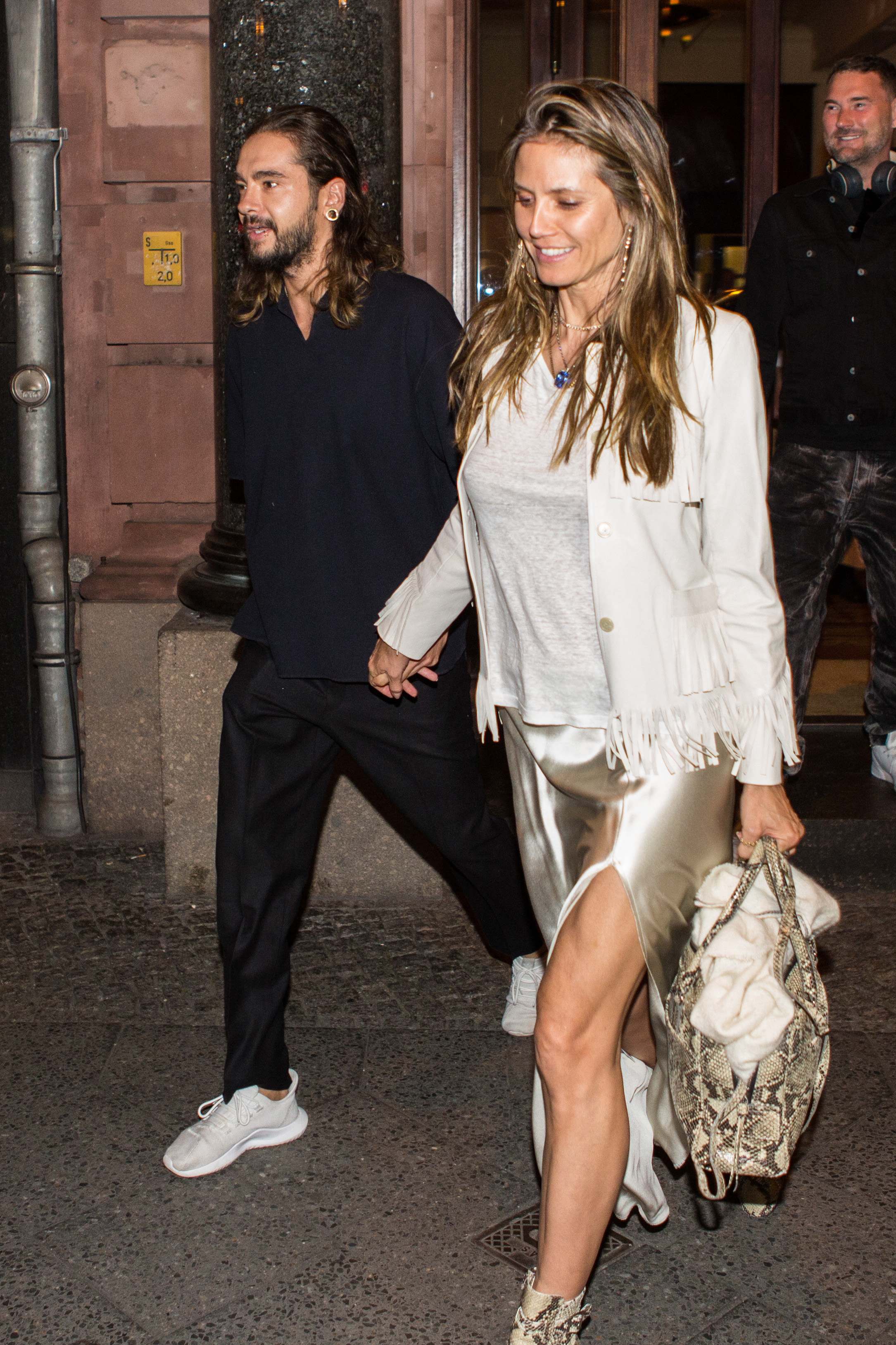EXCLUSIVE: **PREMIUM EXCLUSIVE RATES APPLY** Heidi Klum and Tom Kaulitz at the Borchardt Restaurant in Berlin, Germany. The supermodel and the musician decided to dine at the Borchardt Restaurant on Sunday night.In the restaurant they kissed again and again and exchange caresses. When they left the restaurant, they came out in good spirits with Tom's brother Bill Kaulitz and fashion designer Michael Michalski <P> Pictured: Heidi Klum, Tom Kaulitz, Michael Michalski <B>Ref: SPL1689442  300418   EXCLUSIVE</B><BR/> Picture by: Splash News<BR/> </P><P> <B>Splash News and Pictures</B><BR/> Los Angeles:310-821-2666<BR/> New York:212-619-2666<BR/> London:870-934-2666<BR/> <span id=