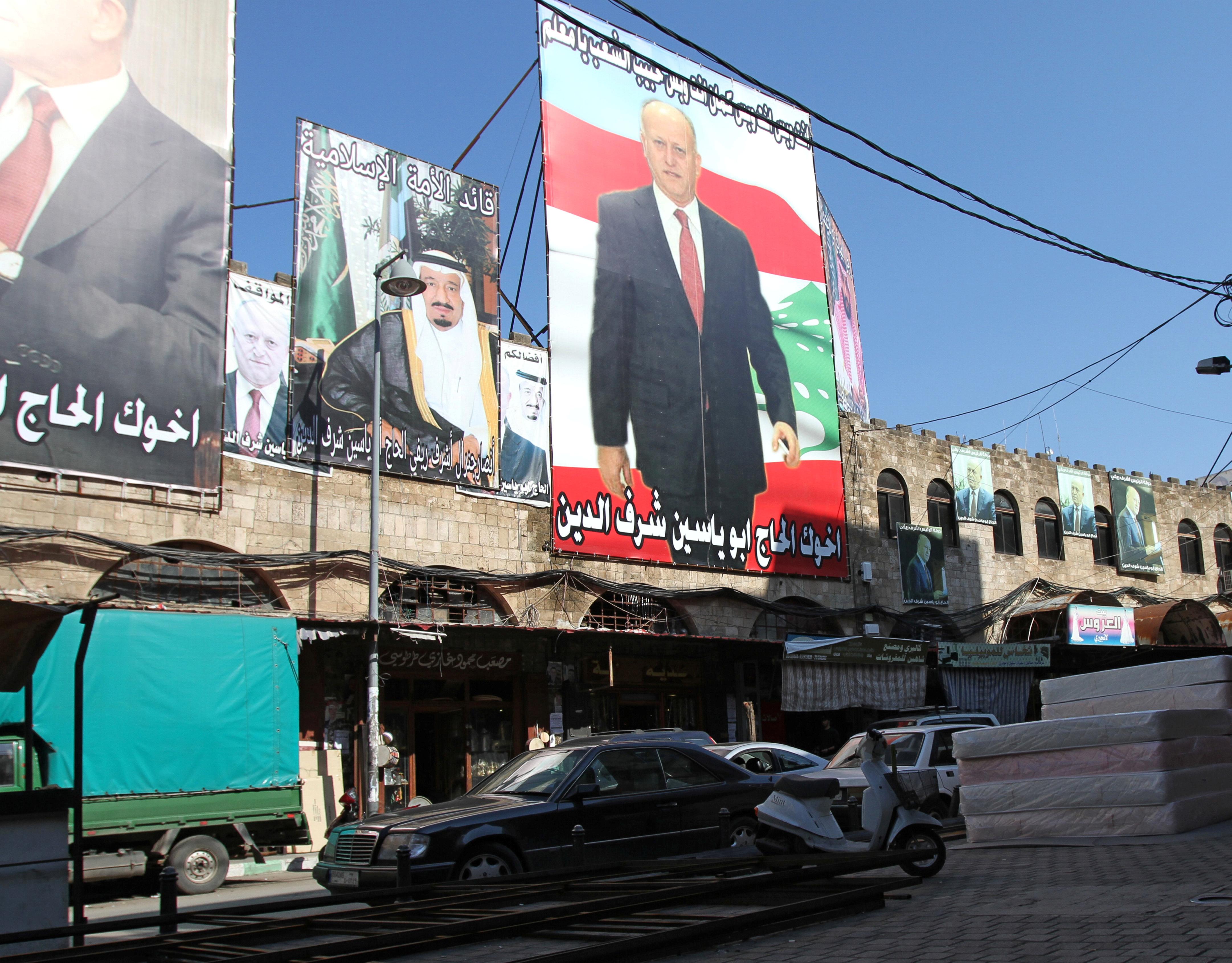 A poster depicting Saudi Arabia's King Salman bin Abdulaziz Al Saud is seen in Tripoli, northern Lebanon, November 7, 2017. REUTERS/Omar Ibrahim - RC147020BF90