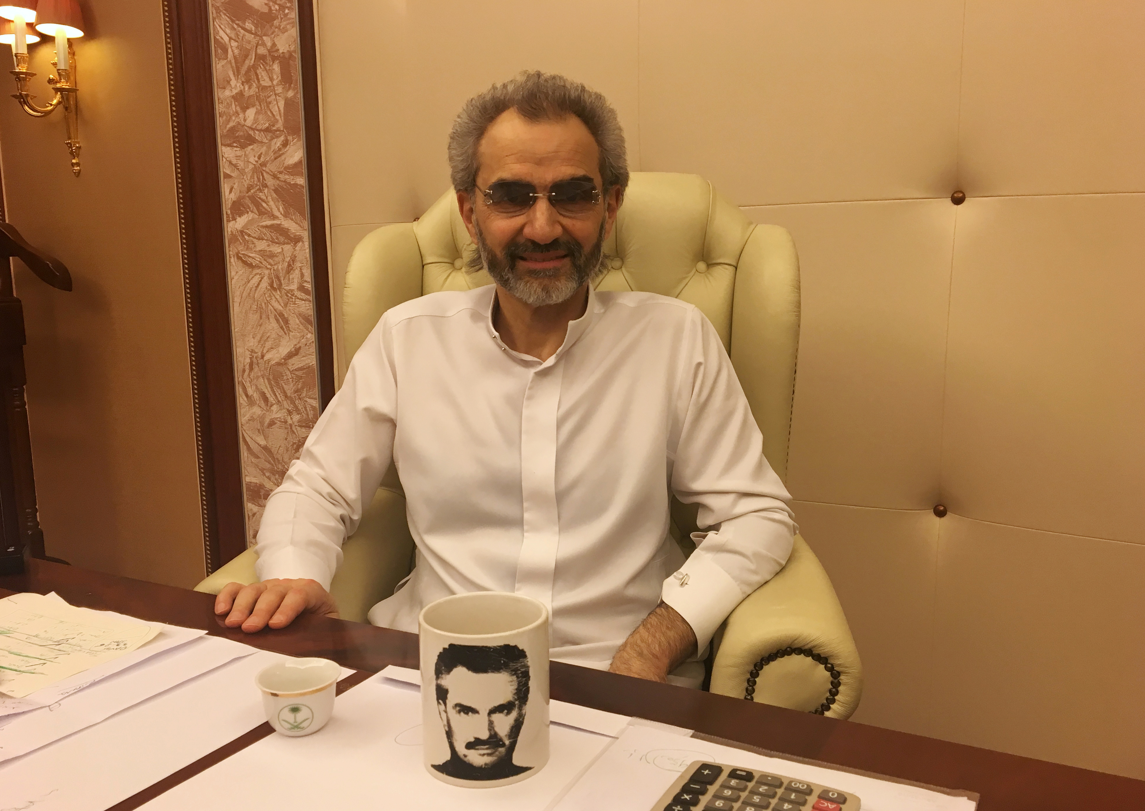 Saudi Arabian billionaire Prince Alwaleed bin Talal sits for an interview with Reuters in the office of the suite where he has been detained at the Ritz-Carlton in Riyadh, Saudi Arabia January 27, 2018, REUTERS/Katie Paul - RC1DEE4DE860