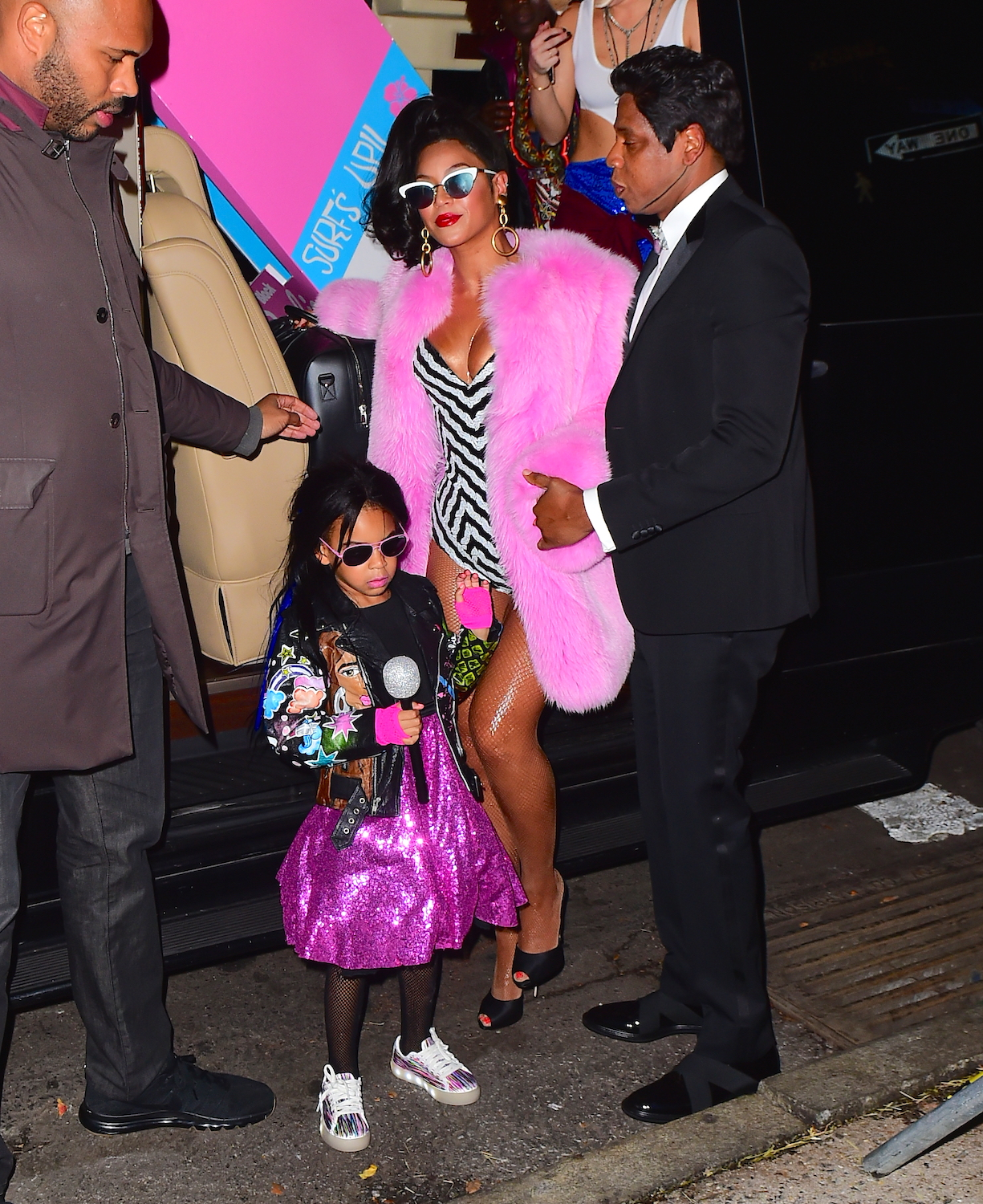 Beyonce and Jay Z were spotted arriving to their Annual Halloween Party in NYC . The couple dressed as a super stylish Black Barbie and Black Ken Doll set. Beyonce stunned in a Pink Fur Coat and a striped Bodysuit. She wore a mirrored pair of sunglasses as she walked with her Husband Jay Z and cute daughter Blue Ivy into the party. They were joined by Kelly Rowland as well, who dressed up as RUN DMC <P> Pictured: Beyonce, Jay Z , <B>Ref: SPL1384685  011116  </B><BR/> Picture by: 247PAPS.TV / Splash News<BR/> </P><P> <B>Splash News and Pictures</B><BR/> Los Angeles:310-821-2666<BR/> New York:212-619-2666<BR/> London:870-934-2666<BR/> <span id=