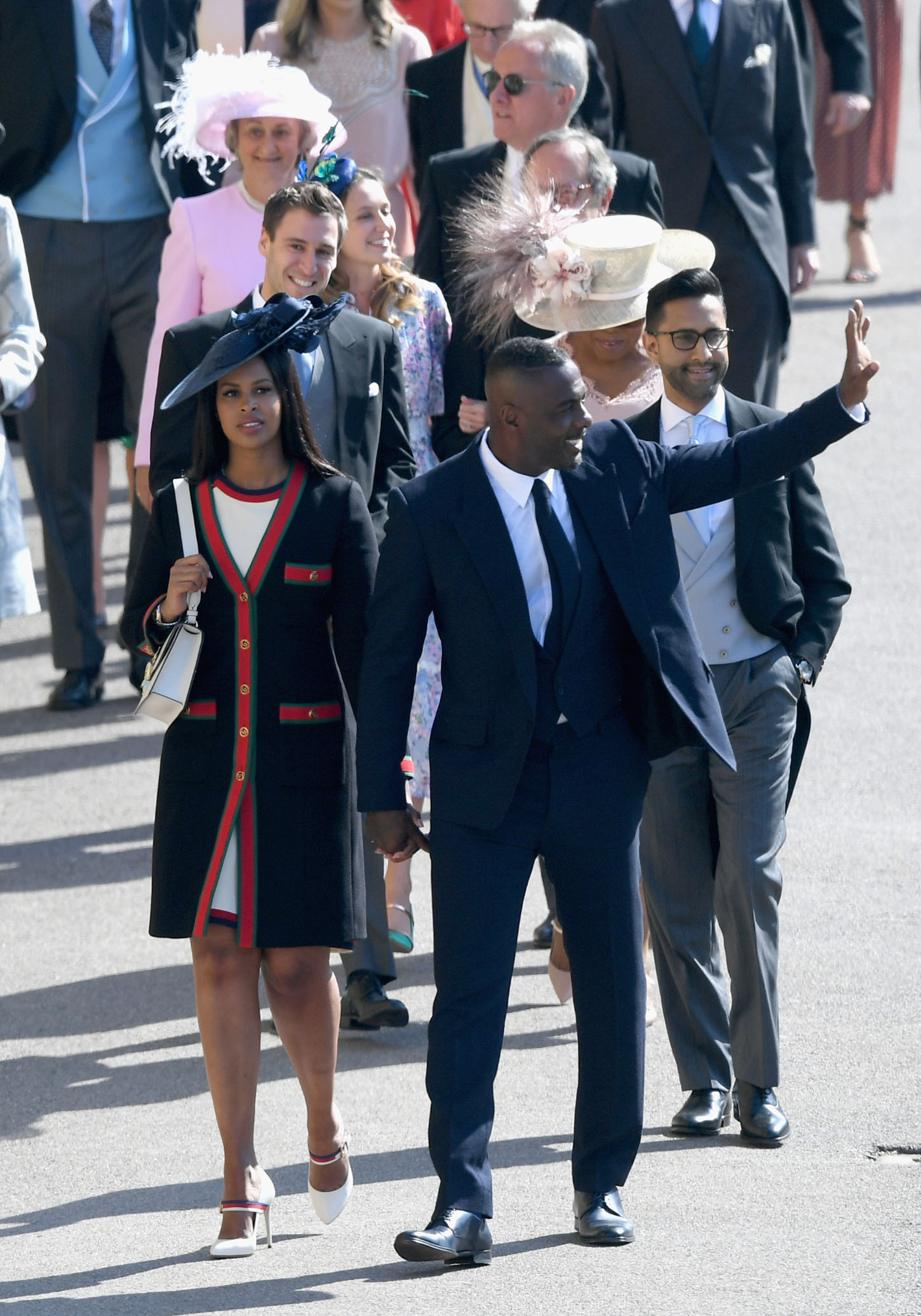 WINDSOR, ENGLAND - MAY 19:  Sabrina Dhowre (L) and Idris Elba attend the wedding of Prince Harry to Ms Meghan Markle at St George's Chapel, Windsor Castle on May 19, 2018 in Windsor, England. Prince Henry Charles Albert David of Wales marries Ms. Meghan Markle in a service at St George's Chapel inside the grounds of Windsor Castle. Among the guests were 2200 members of the public, the royal family and Ms. Markle's Mother Doria Ragland.  (Photo by Shaun Botterill/Getty Images)