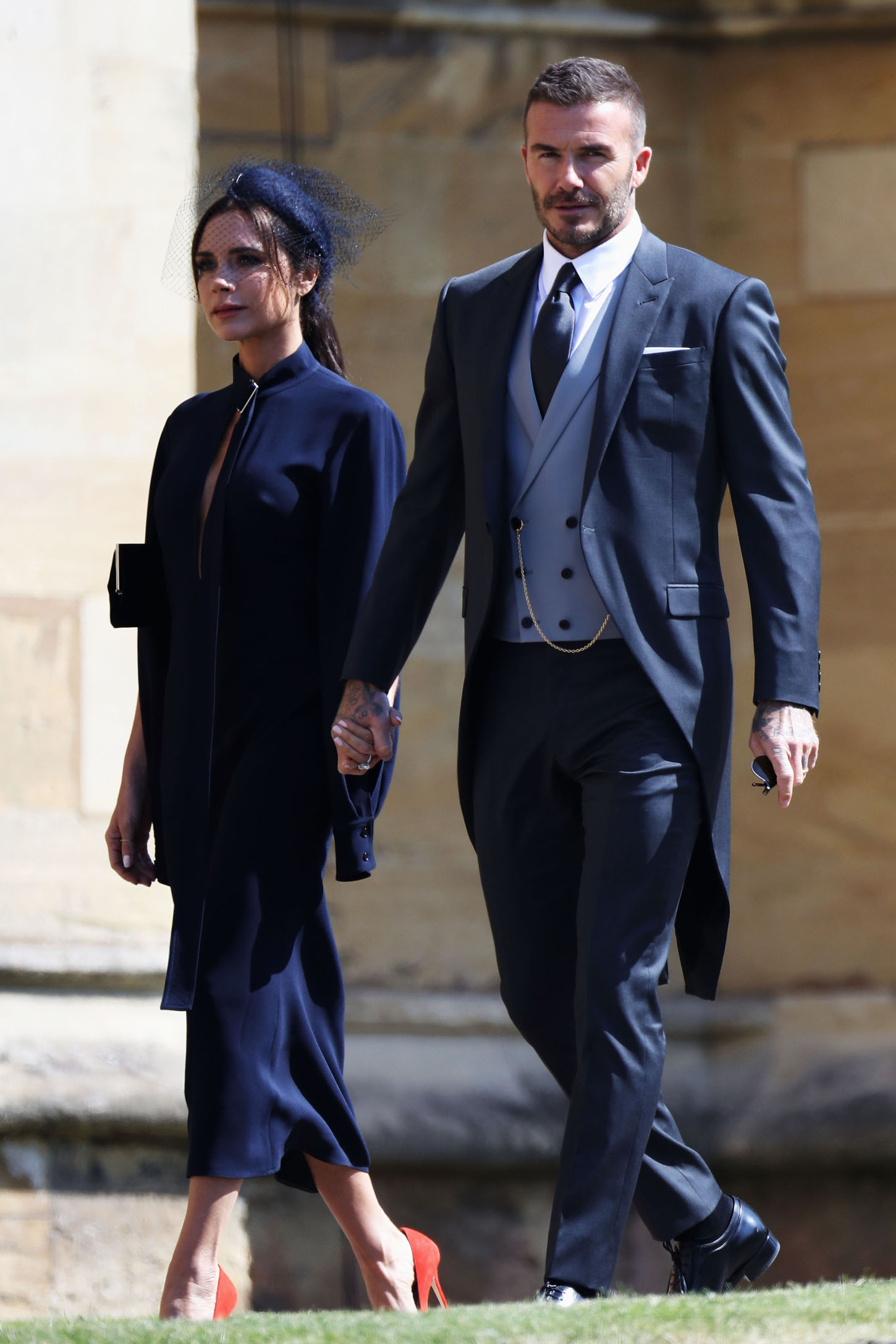 WINDSOR, ENGLAND - MAY 19: Victoria Beckham and David Beckham arrive at the wedding of Prince Harry to Ms Meghan Markle at St George's Chapel, Windsor Castle on May 19, 2018 in Windsor, England.  (Photo by Chris Jackson/Getty Images)